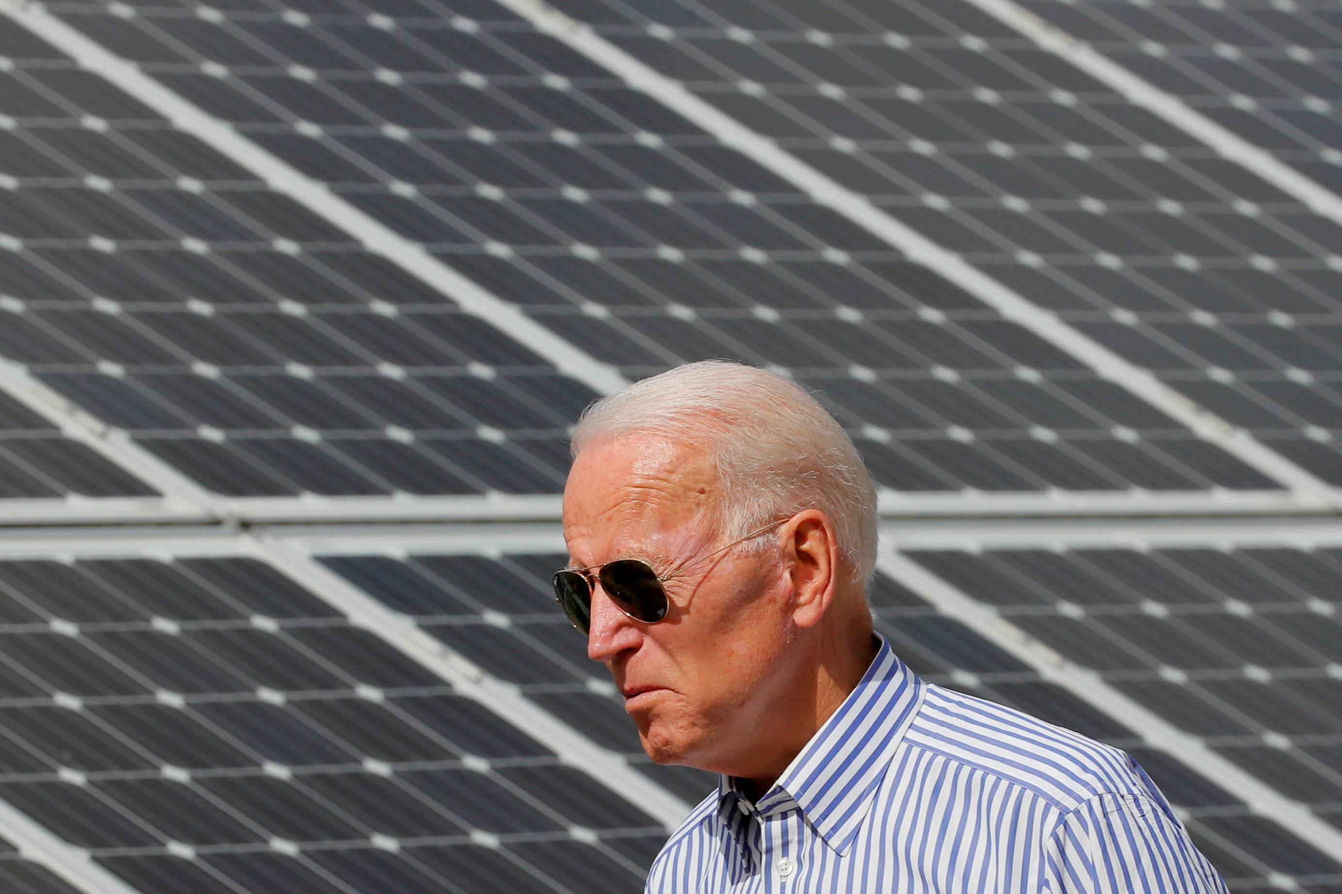 Democratic 2020 U.S. presidential candidate and former Vice President Joe Biden walks past solar panels while touring the Plymouth Area Renewable Energy Initiative in Plymouth, New Hampshire, U.S., June 4, 2019.   REUTERS/Brian Snyder