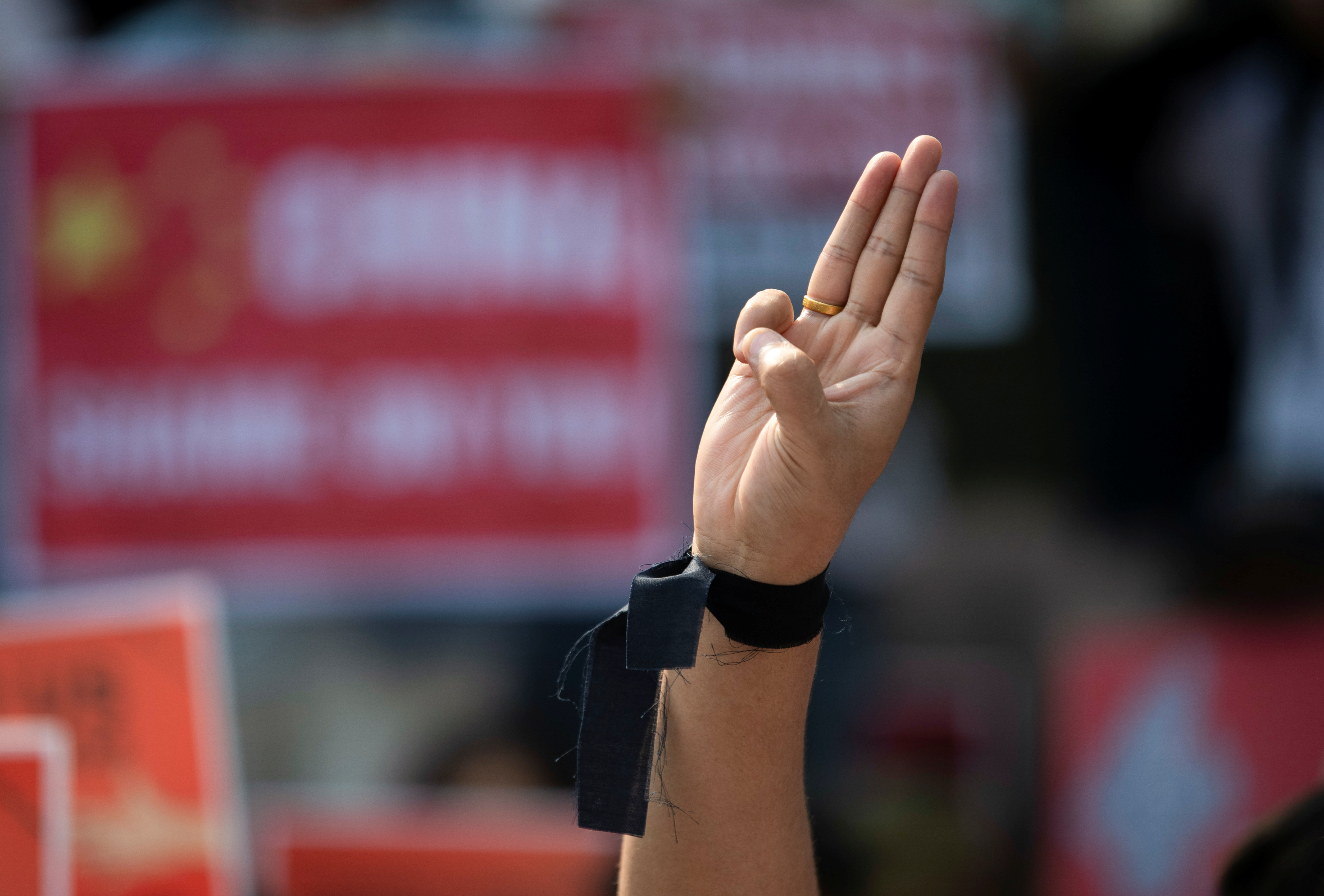 A demonstrator shows the three-finger salute during a protest against the military coup in Yangon, Myanmar, February 21, 2021. REUTERS/Stringer