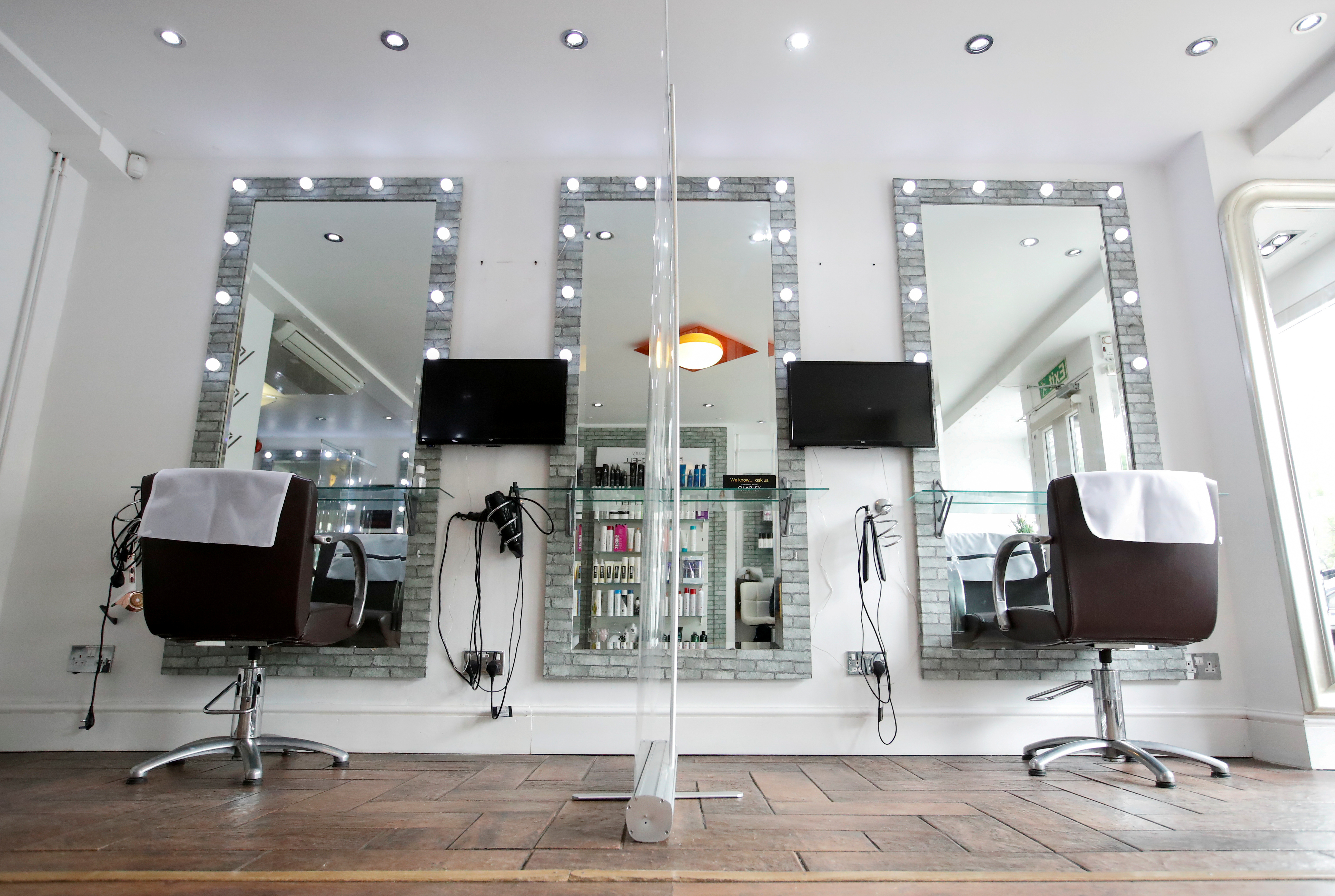 A view shows a divider screen in the Evolve hair salon as it is being prepared for a reopening on July 4, following the outbreak of the coronavirus disease (COVID-19), in Fenny Stratford in Milton Keynes, Britain July 2, 2020. REUTERS/Andrew Boyers/File Photo