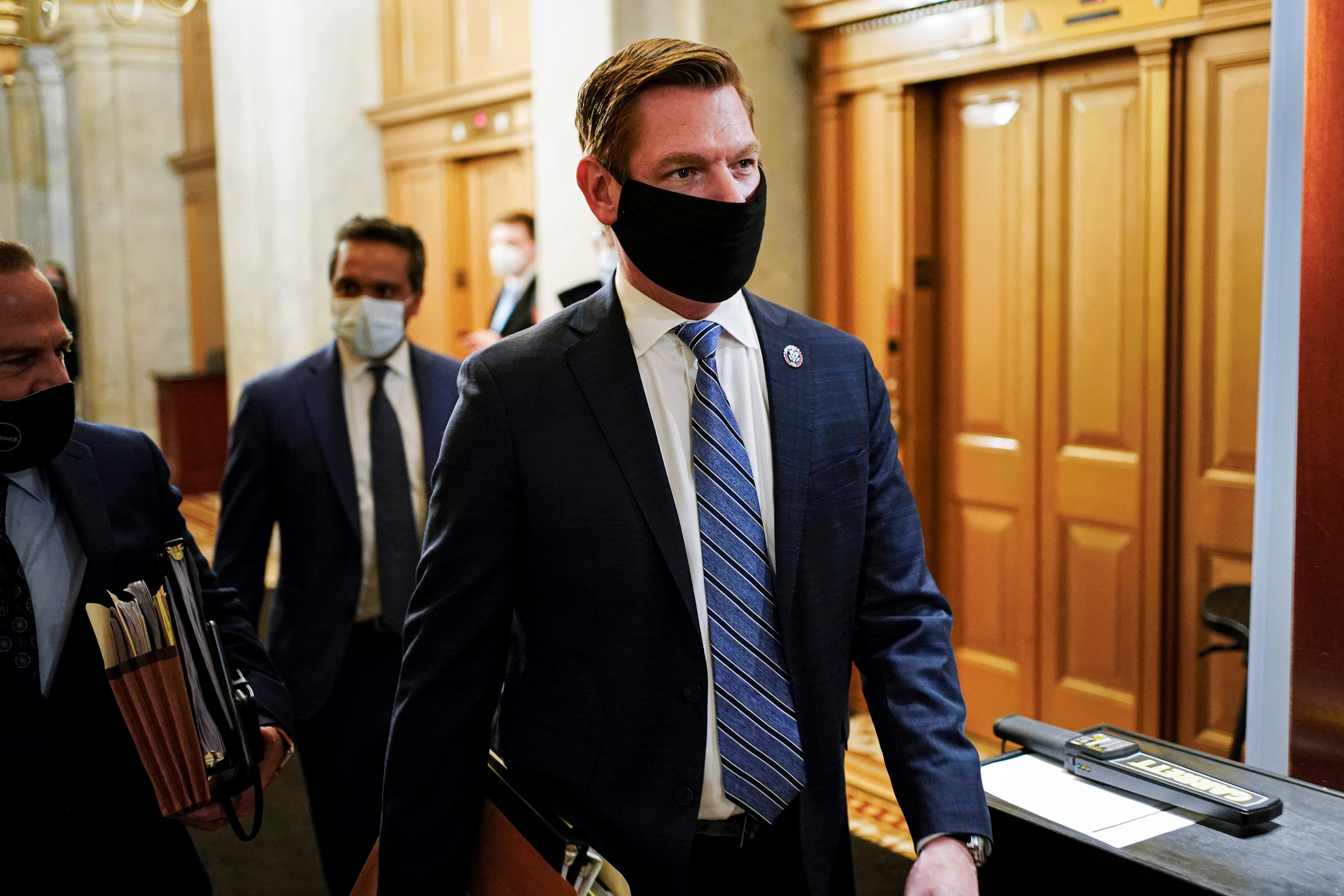 House Impeachment Manager Rep. Eric Swalwell (D-CA) departs after the day's proceedings concluded in the impeachment trial of former U.S. President Donald Trump, on charges of inciting the deadly attack on the U.S. Capitol, on Capitol Hill in Washington, U.S., February 10, 2021. REUTERS/Joshua Roberts/Pool