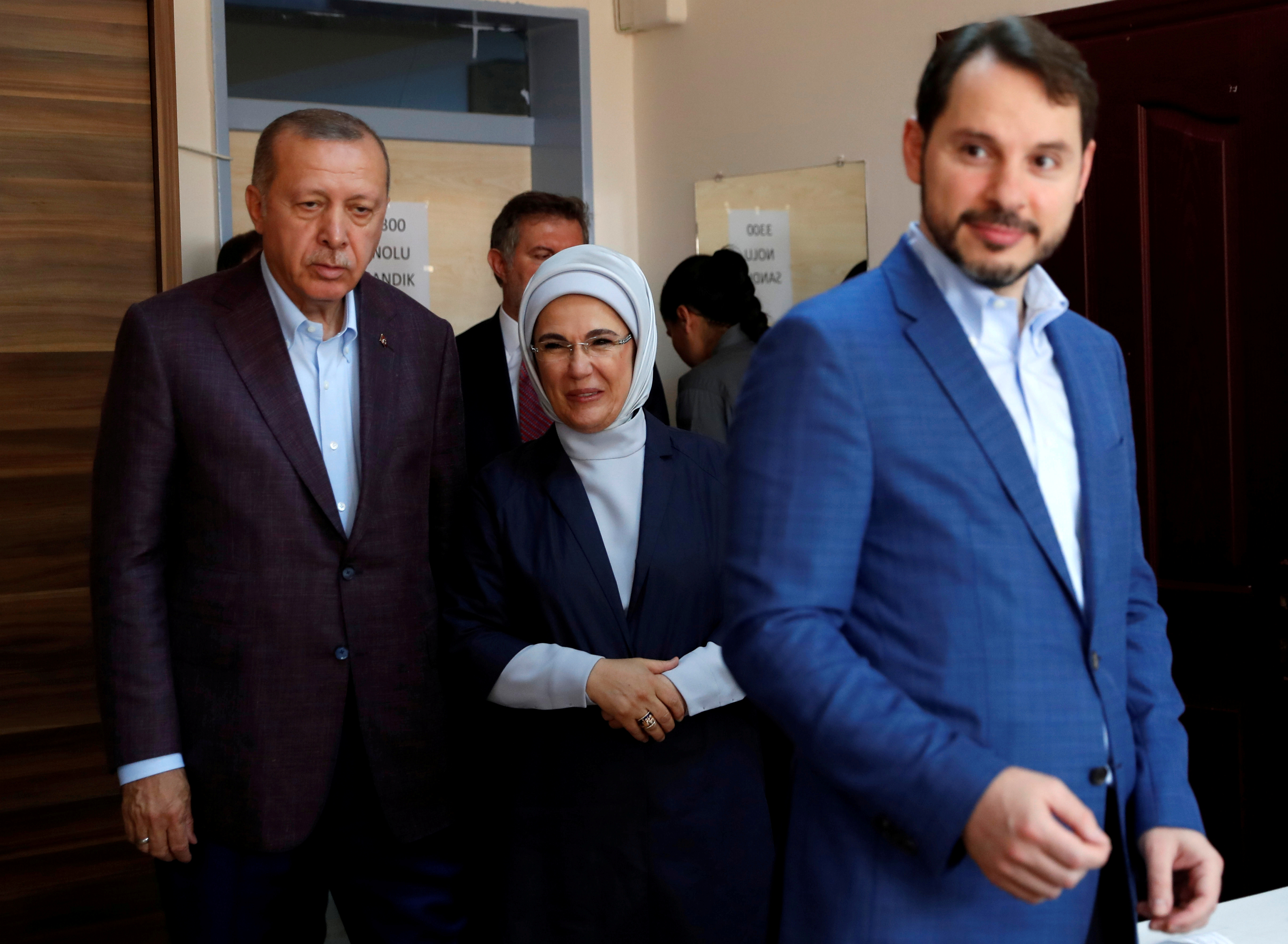 Turkish President Tayyip Erdogan and his wife Emine look on after Turkish Treasury and Finance Minister Berat Albayrak cast his ballot at a polling station in Istanbul, Turkey, June 23, 2019. REUTERS/Murad Sezer/File Photo
