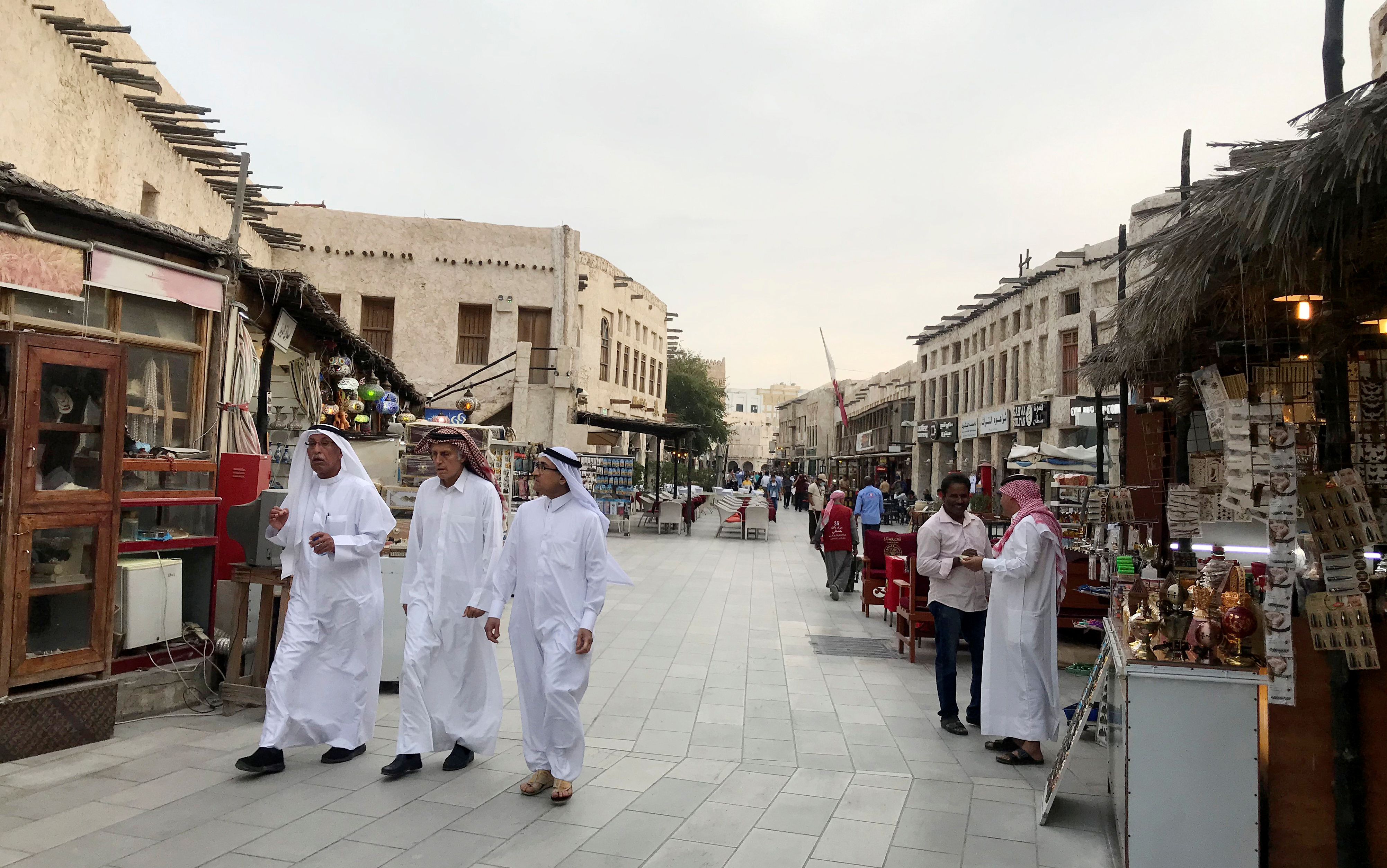 People walk at souq Waqif, following the outbreak of coronavirus, in Doha, Qatar March 12,2020. REUTERS/stringer