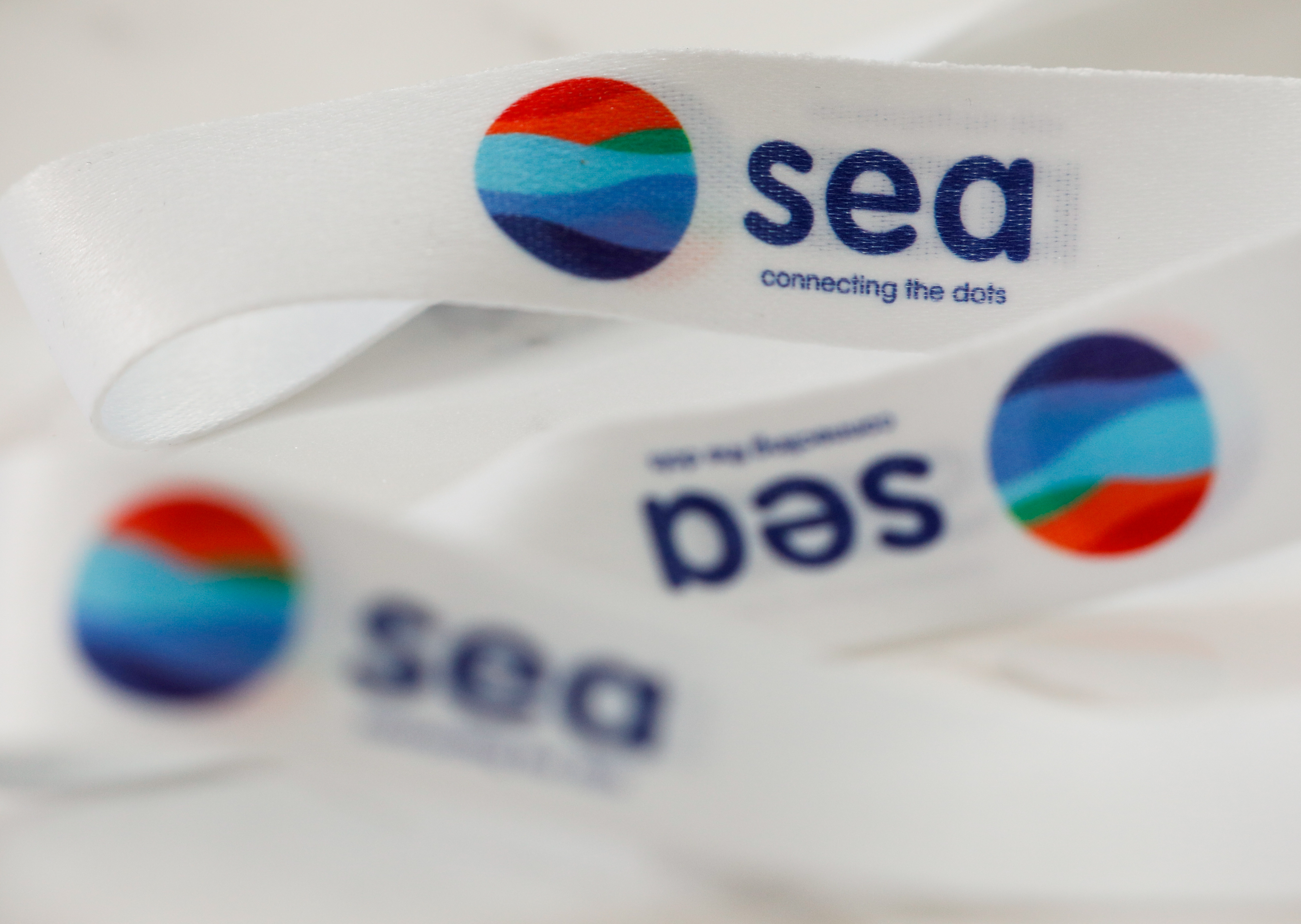 A lanyard showing logos of Southeast Asian e-commerce and gaming group Sea Ltd is pictured at its office in Singapore, March 5, 2021. REUTERS/Edgar Su/File Photo