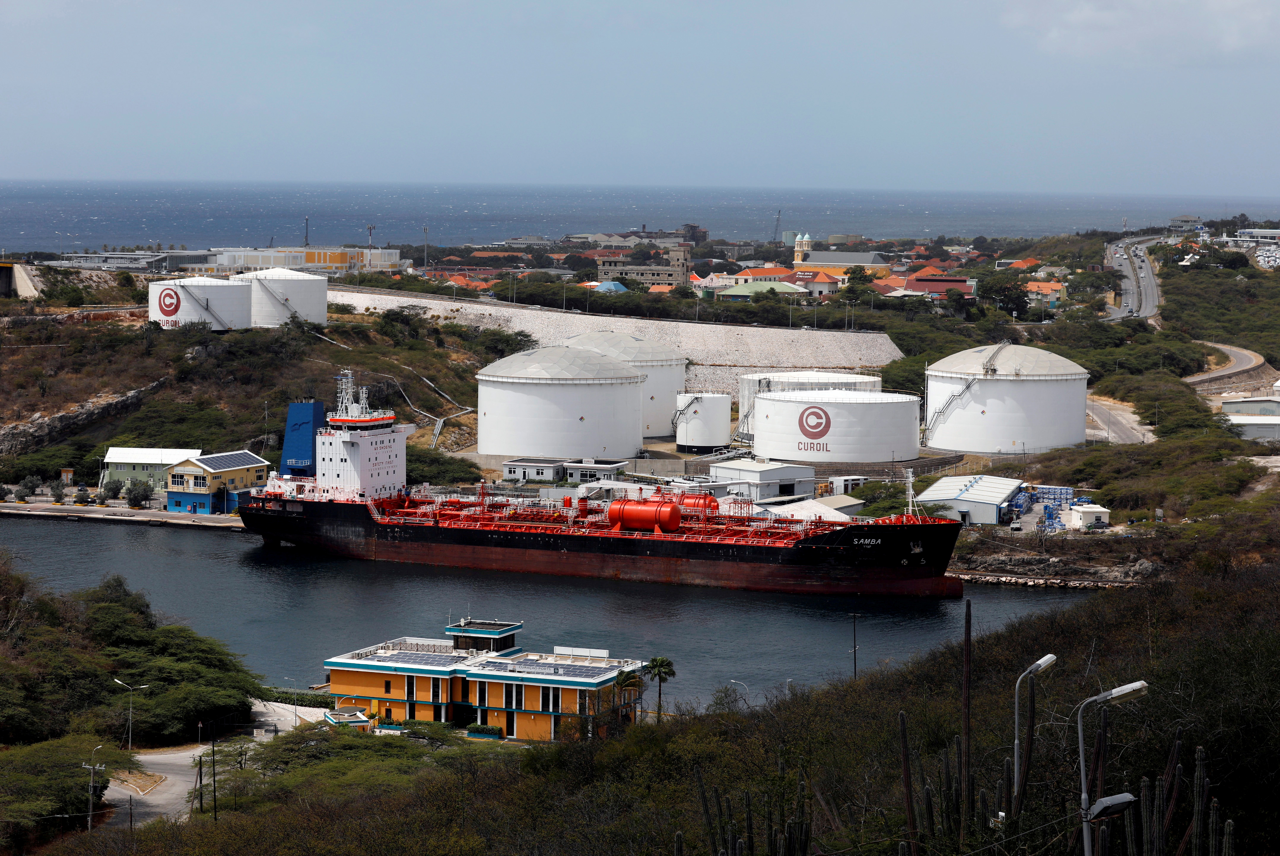 A crude oil tanker is docked at Isla Oil Refinery PDVSA terminal in Willemstad on the island of Curacao, February 22, 2019. REUTERS/Henry Romero/File Photo