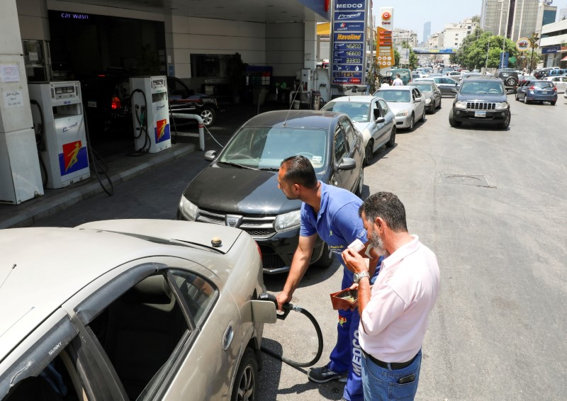 A worker fills up a car with fuel at a gas station in Beirut, Lebanon June 24, 2021. REUTERS/Mohamed Azakir