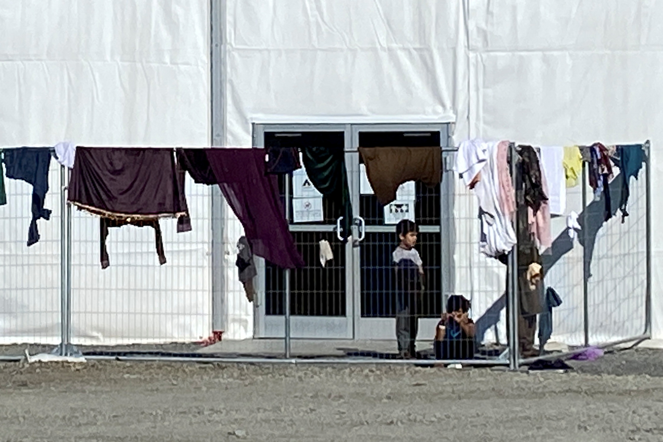A structure housing Afghan evacuees is seen at Joint Base McGuire-Dix-Lakehurst, New Jersey, which has surged housing and supplies to host more than 9,300 Afghans awaiting resettlement in the United States, September 27, 2021. REUTERS/Phil Stewart
