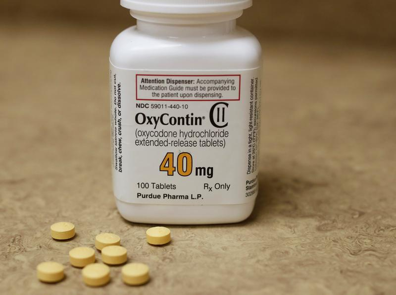 A bottle of prescription painkiller OxyContin, 40mg pills, made by Purdue Pharma L.D. sit on a counter at a local pharmacy, in Provo, Utah, U.S., April 25, 2017. REUTERS/George Frey - RC1D92248F10