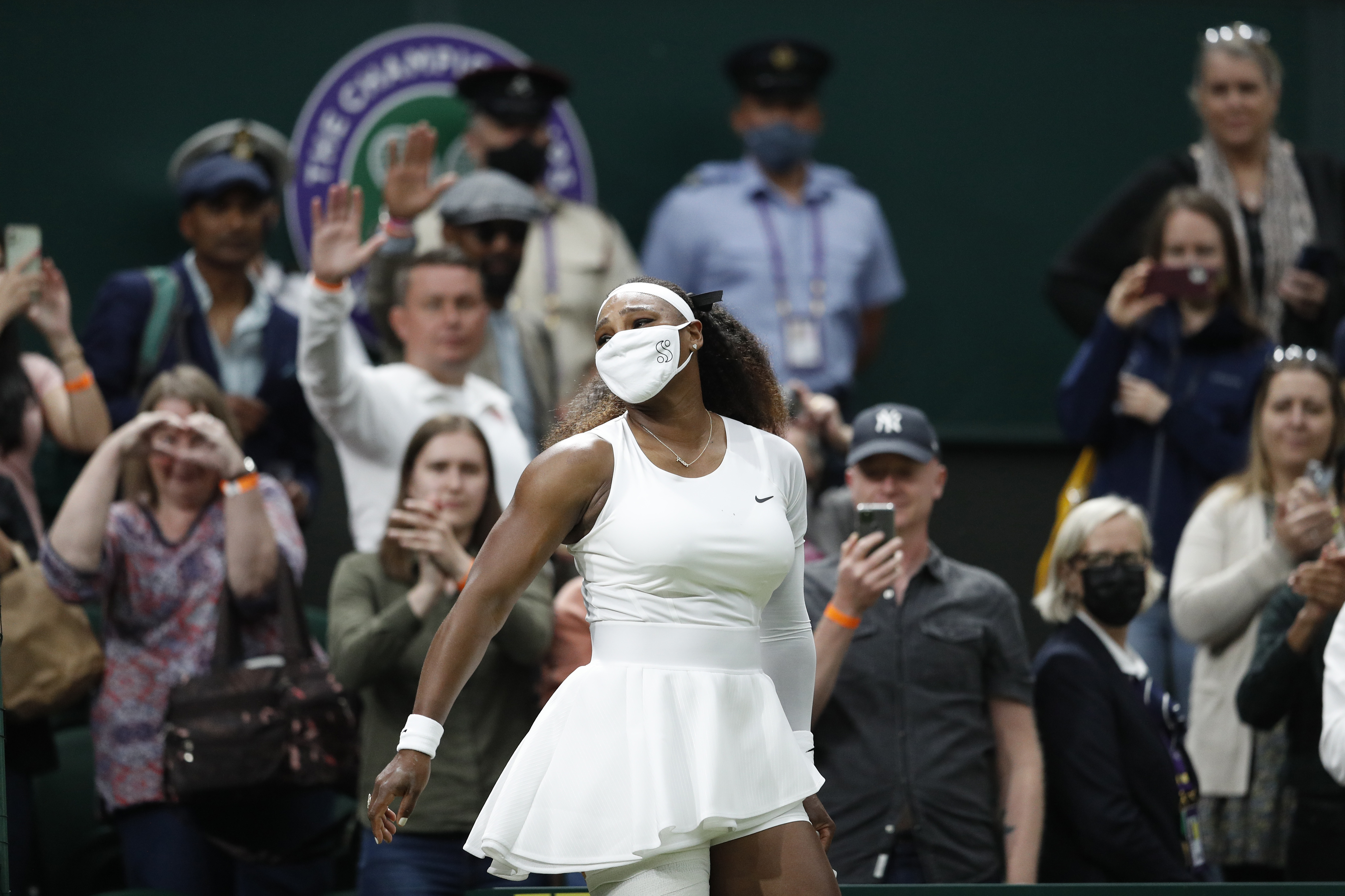 Tennis - Wimbledon - All England Lawn Tennis and Croquet Club, London, Britain - June 29, 2021 Serena Williams of the U.S. leaves court as she retires from her first round match against Belarus' Aliaksandra Sasnovich after sustaining an injury REUTERS/Peter Nicholls     TPX IMAGES OF THE DAY