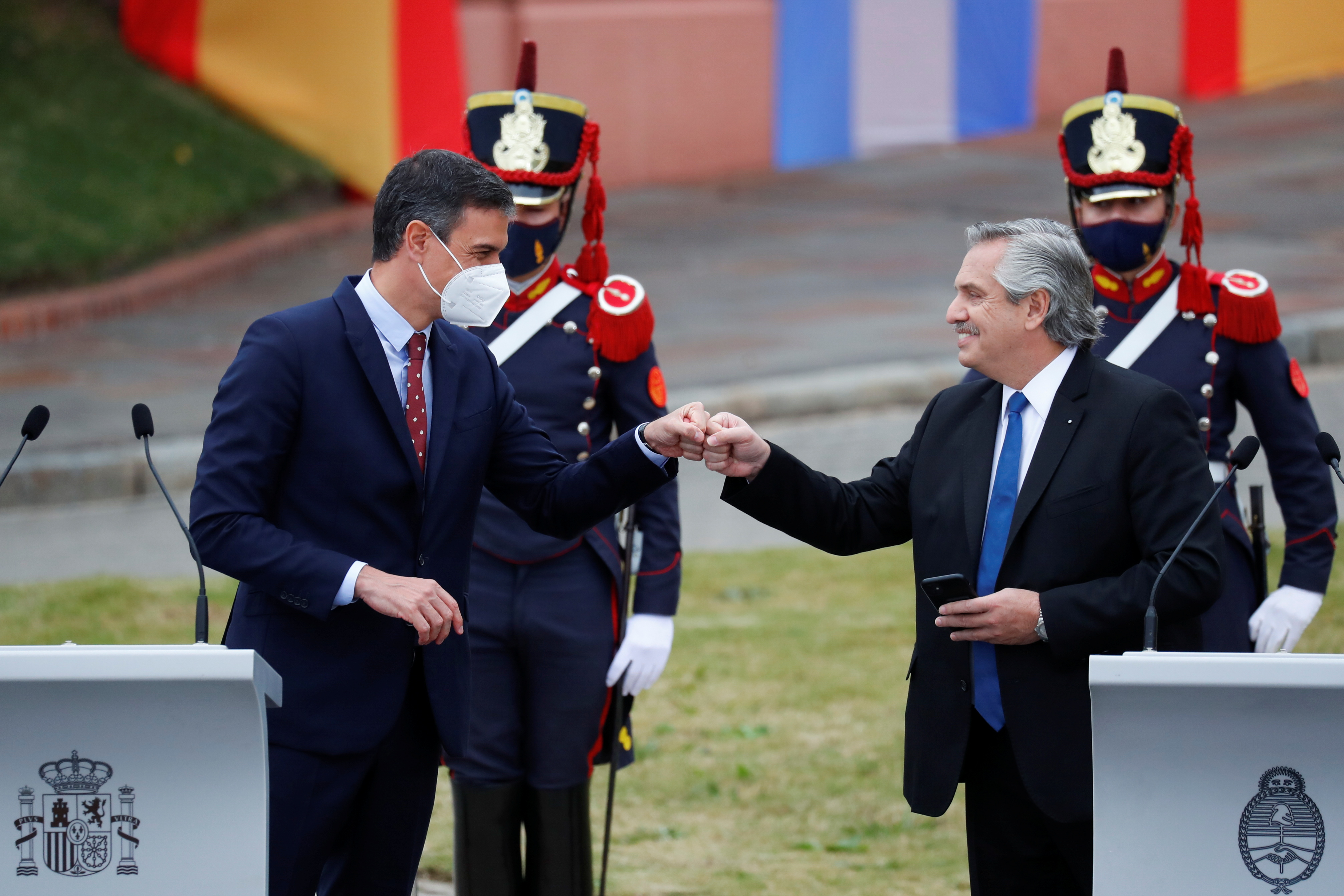 Argentina's President Alberto Fernandez fist bumps Spain's Prime Minister Pedro Sanchez at the Casa Rosada presidential palace, in Buenos Aires, June 9, 2021. REUTERS/Agustin Marcarian