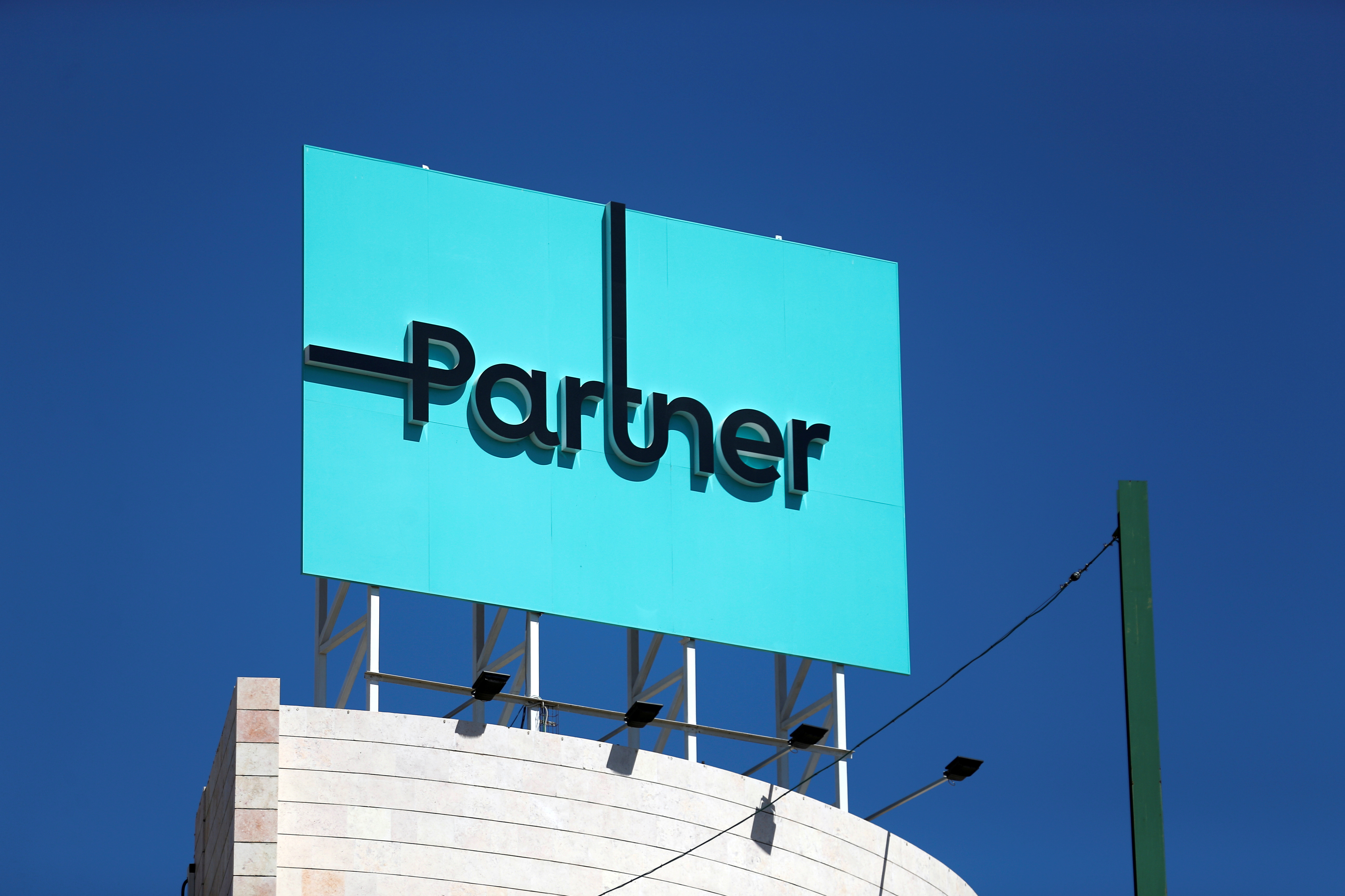 The logo of Partner, an Israeli communication firm, is seen on their headquarters in Rosh Ha'ayin near Tel Aviv, Israel June 21, 2016. REUTERS/Amir Cohen