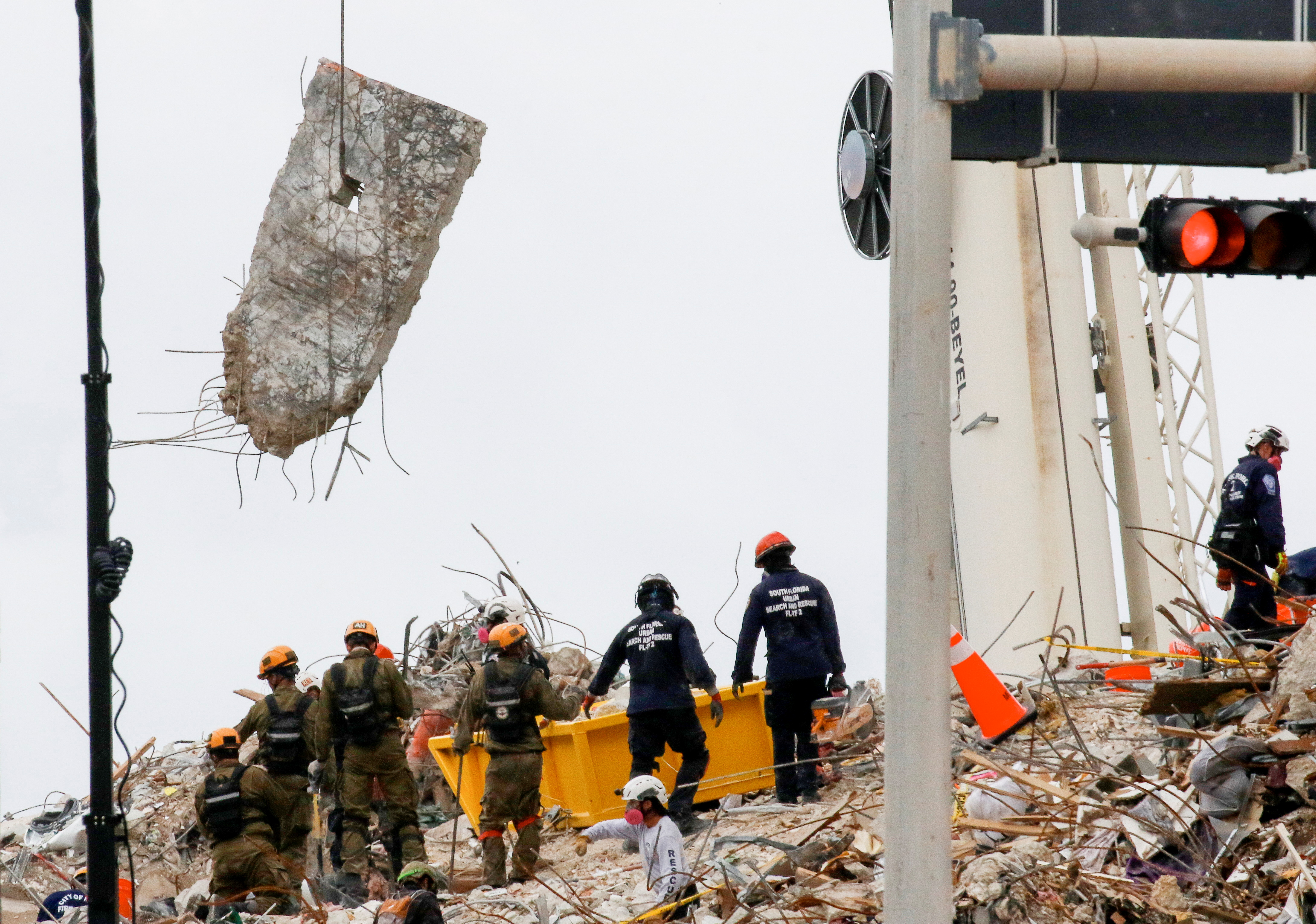 Emergency workers conduct search and rescue efforts at the site of a partially collapsed residential building in Surfside, near Miami Beach, Florida, U.S. June 29, 2021. REUTERS/Joe Skipper