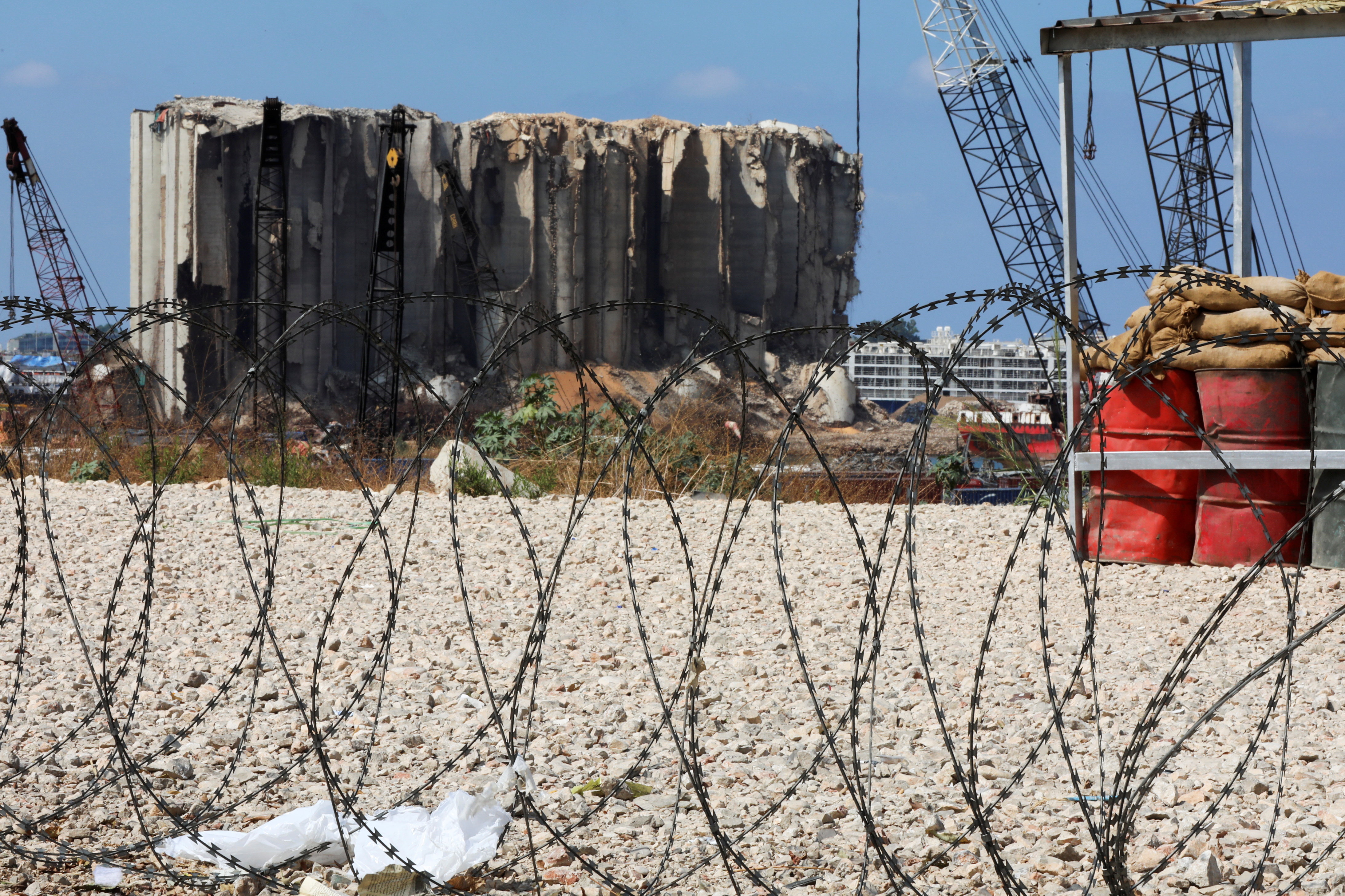 Razor wire is pictured in front of the site of the 2020 Beirut port explosion, Lebanon September 29, 2021. REUTERS/Mohamed Azakir