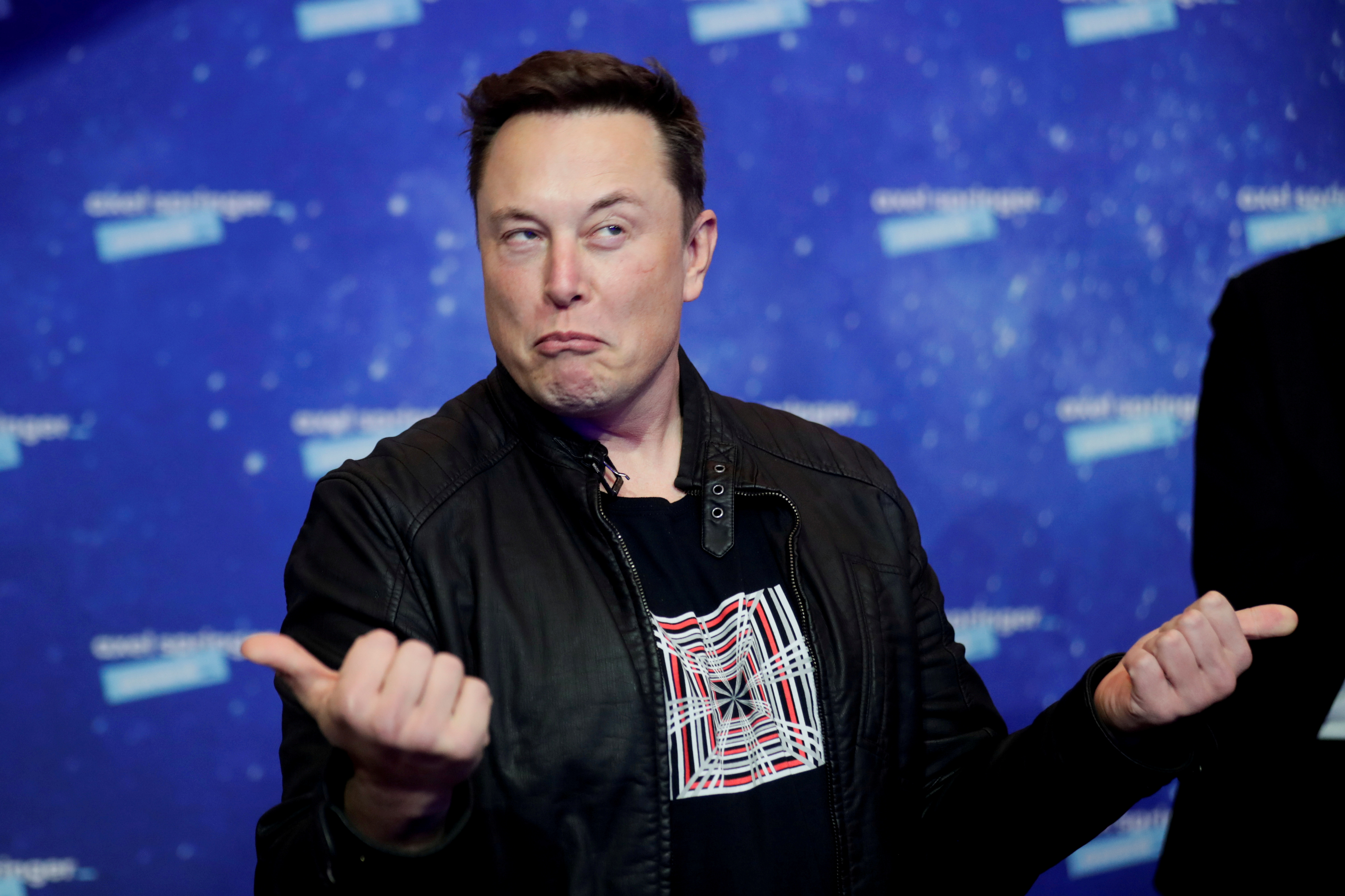 SpaceX owner and Tesla CEO Elon Musk grimaces after arriving on the red carpet for the Axel Springer award, in Berlin, Germany, December 1, 2020. REUTERS/Hannibal Hanschke/Pool