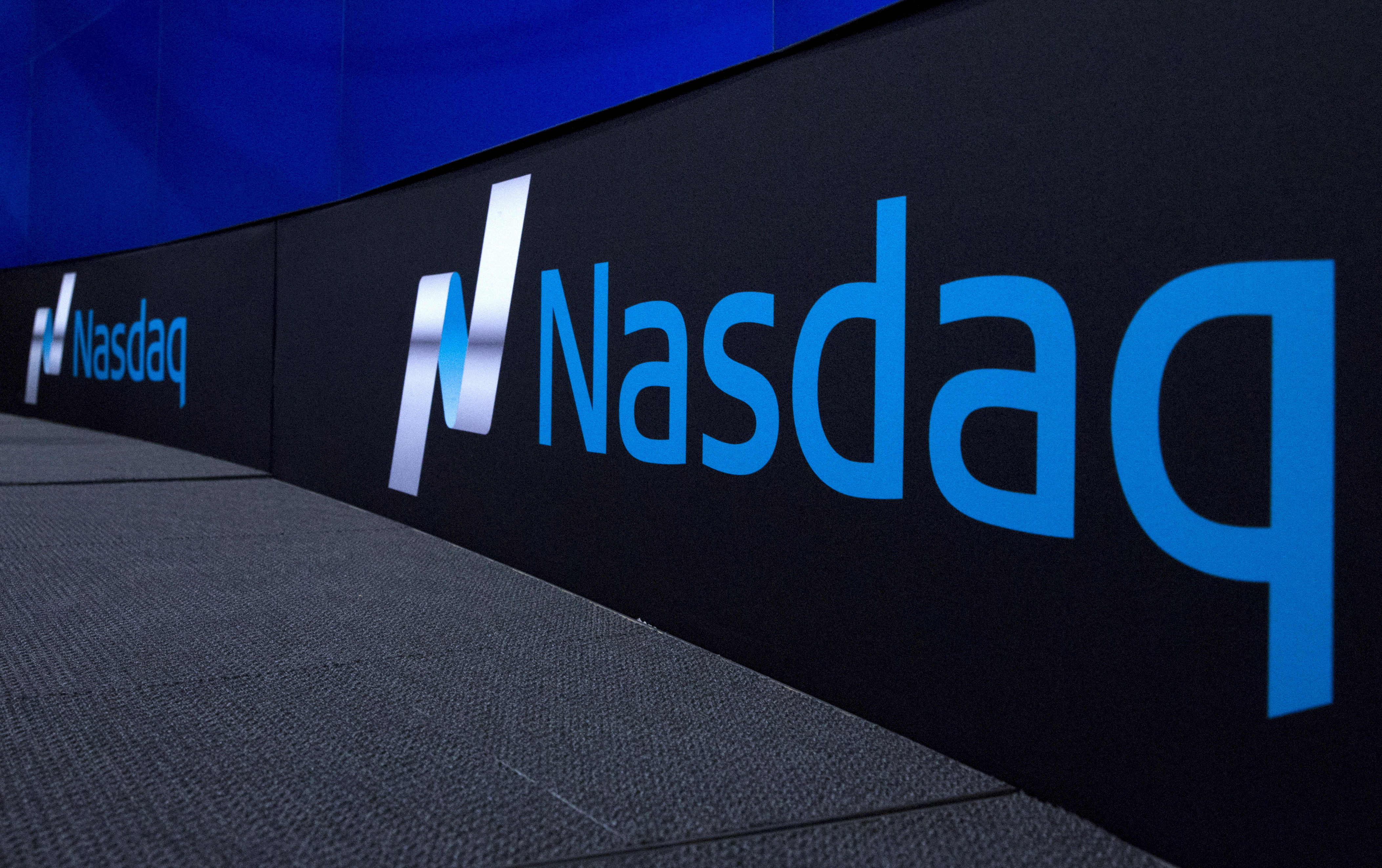 FILE PHOTO: The Nasdaq logo is displayed at the Nasdaq Market site in New York September 2, 2015. REUTERS/Brendan McDermid/File Photo/File Photo