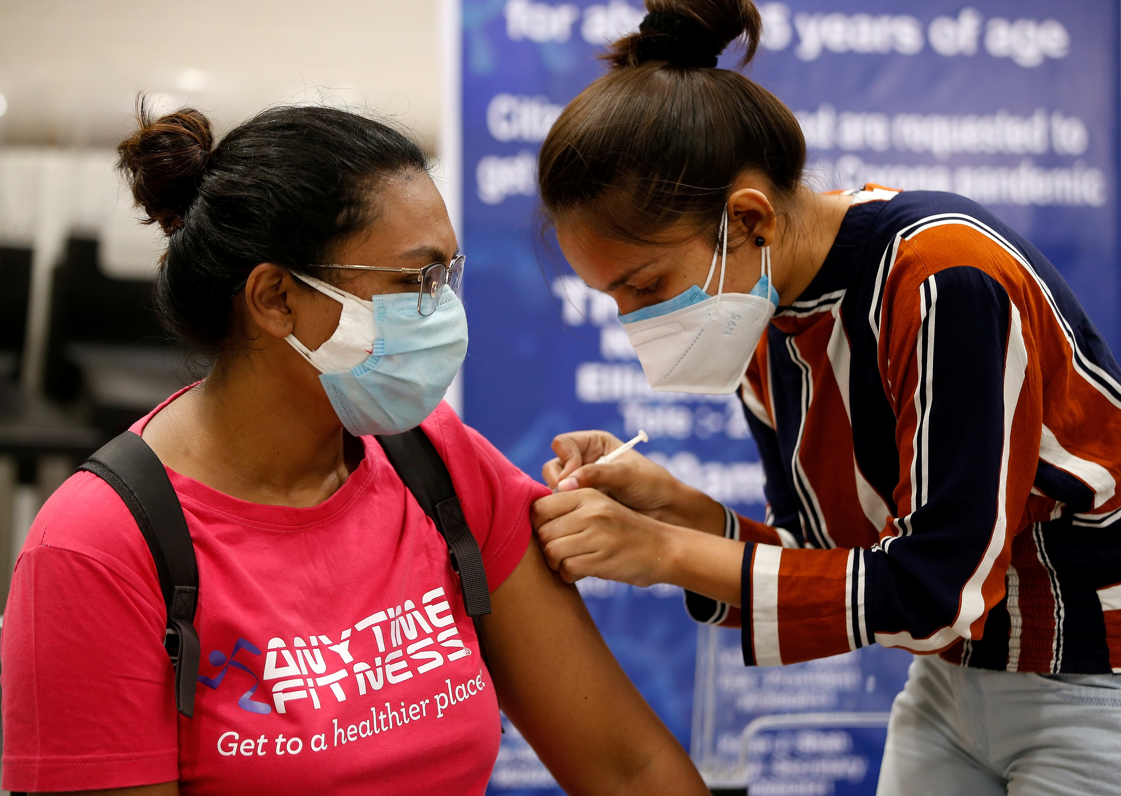 A woman receives a dose of COVISHIELD, a coronavirus disease (COVID-19) vaccine manufactured by Serum Institute of India, at a vaccination centre in Ahmedabad, India, May 1, 2021. REUTERS/Amit Dave