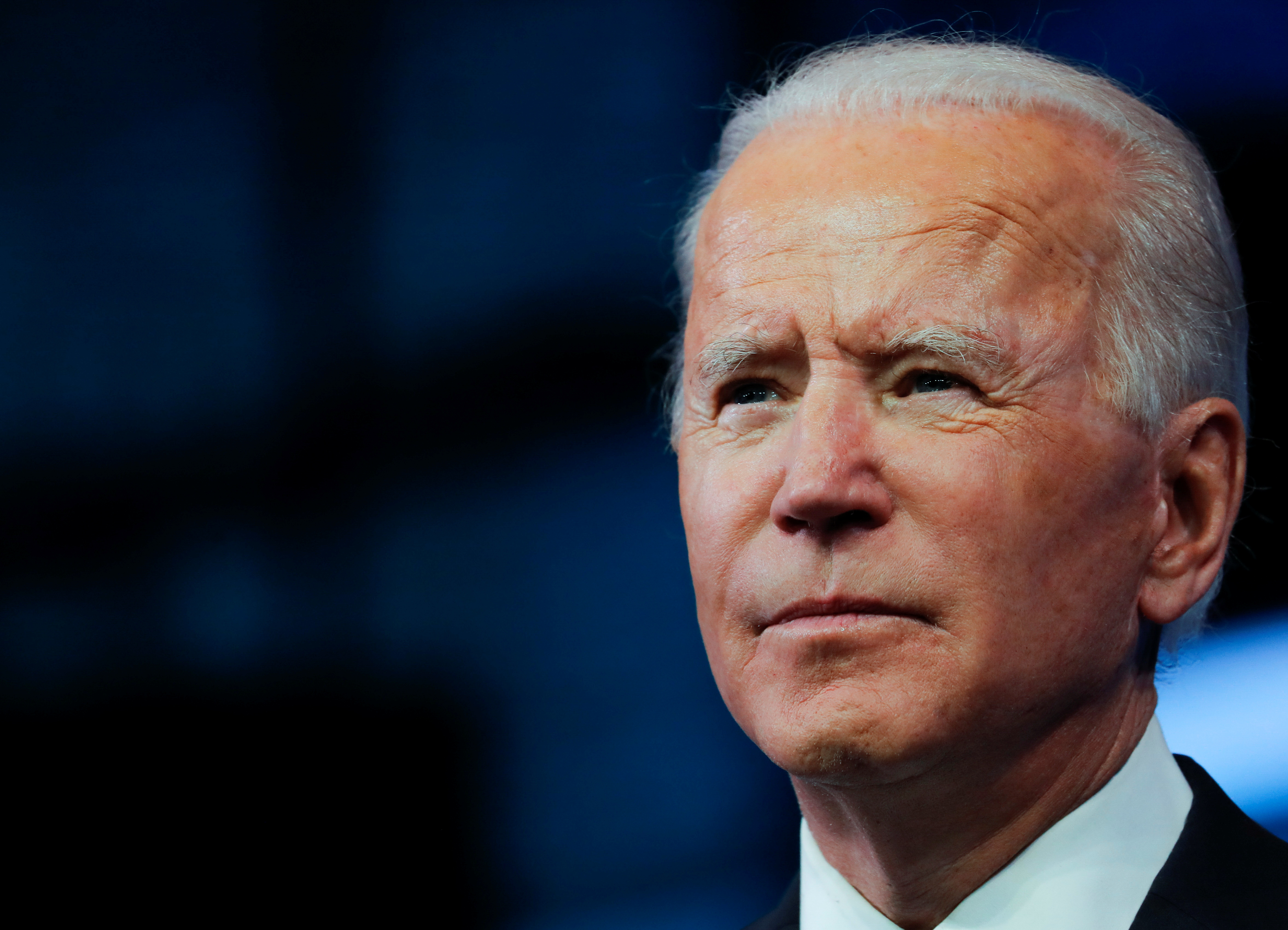 U.S. President-elect Joe Biden pauses as he delivers a televised address to the nation, after the U.S. Electoral College formally confirmed his victory over President Donald Trump in the 2020 U.S. presidential election, from Biden's transition headquarters at the Queen Theater in Wilmington, Delaware, U.S., December 14, 2020. REUTERS/Mike Segar