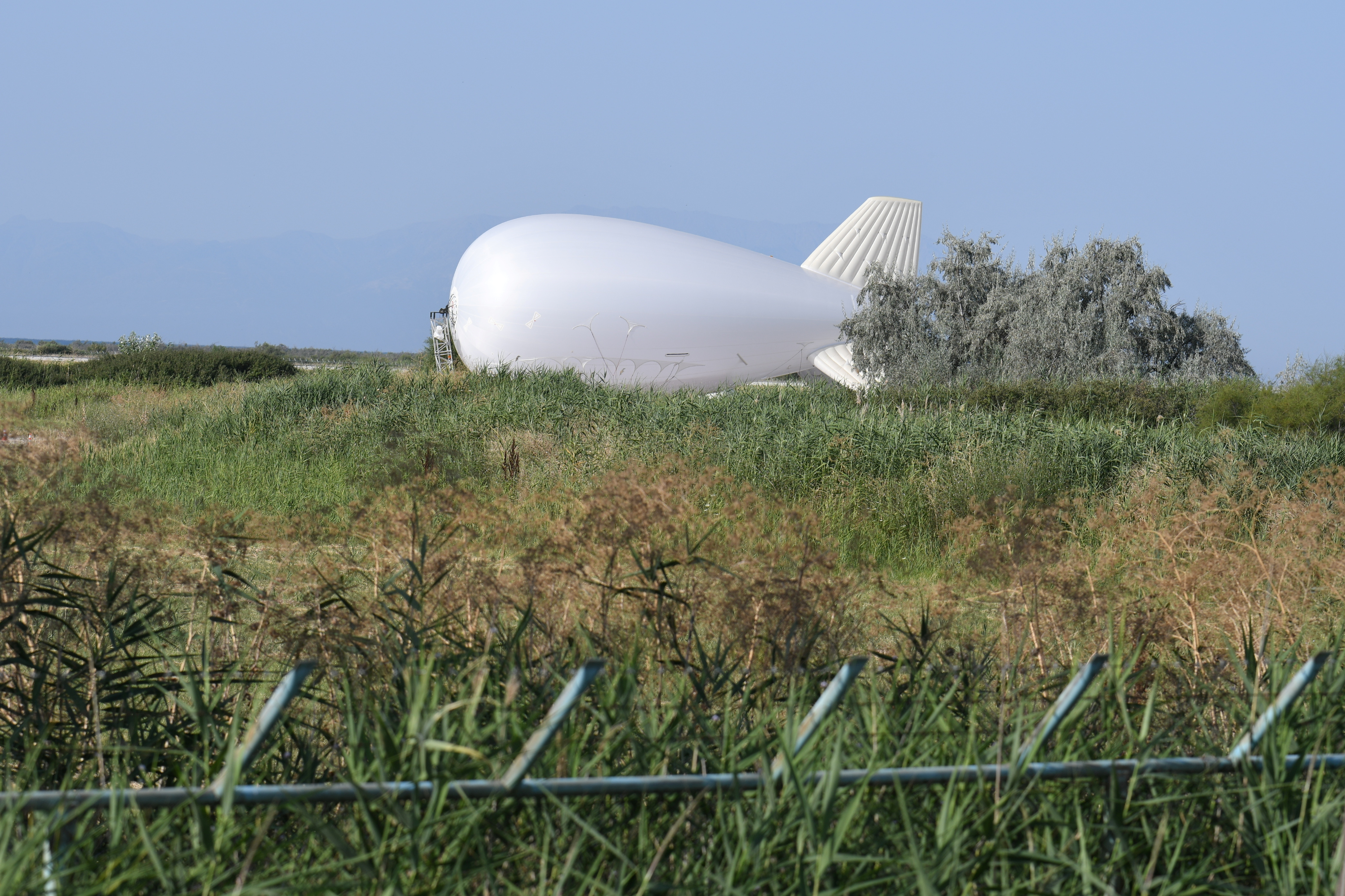 An aerostat balloon system of the European Union's border agency FRONTEX, equipped with high tech surveillance cameras, is seen at the airport of Alexandroupolis, Greece, July 28, 2021. REUTERS/Alexandros Avramidis