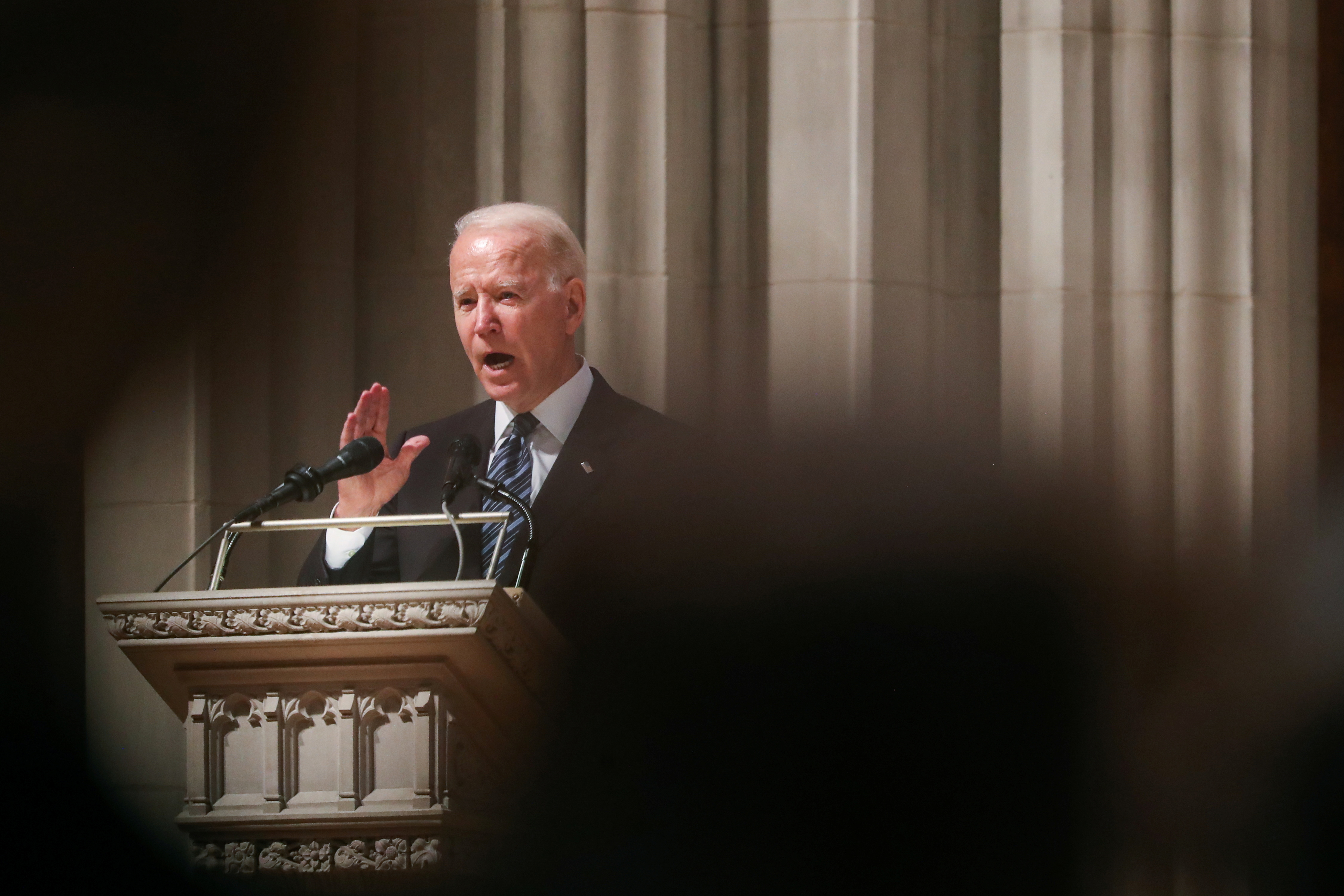 U.S. President Joe Biden speaks during the funeral ceremony of former Senator John Warner at Washington National Cathedral in Washington, DC, U.S. June 23, 2021. Oliver Contreras/Pool via REUTERS