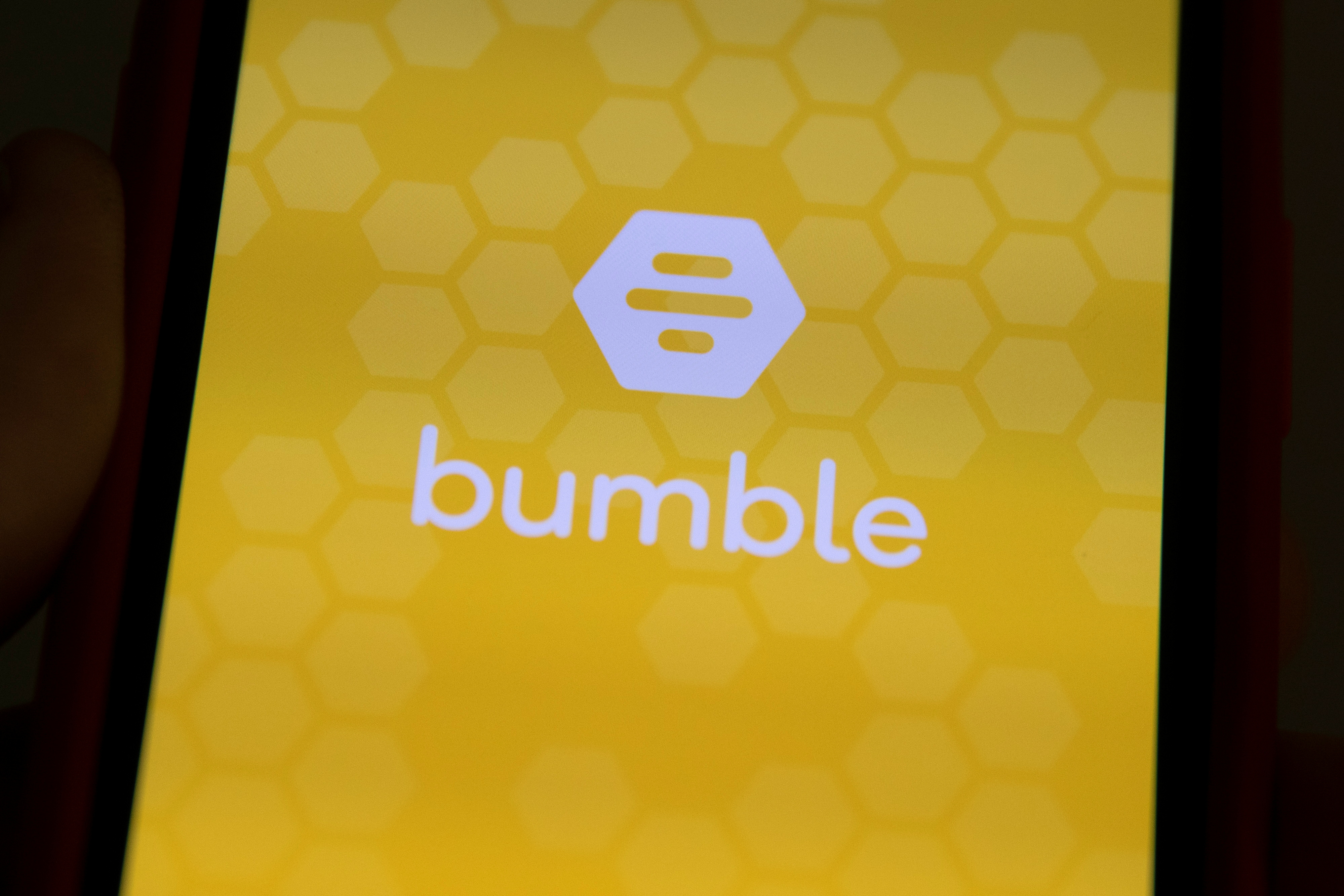 The Bumble Inc. (BMBL) app is shown on an Apple iPhone in this photo illustration as the dating app operator made its debut IPO on the Nasdaq stock exchange February 11, 2021.   REUTERS/Mike Blake/Illustration