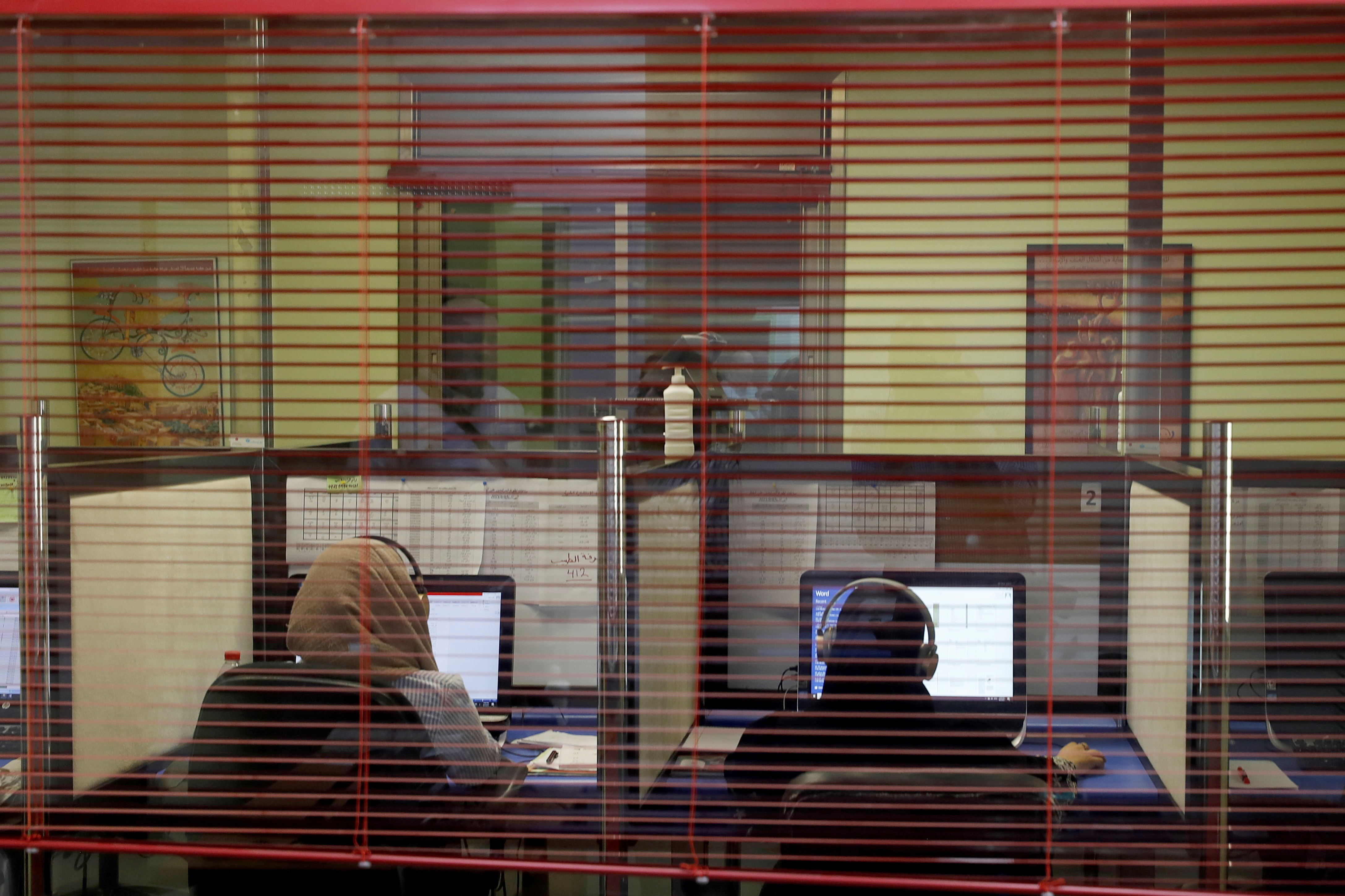 Trauma helpline counselors in Ramallah receive calls from Gaza after the 11-day conflict with Israel, in Ramallah in the Israeli-occupied West Bank June 09 , 2021. Picture taken June 09, 2021. REUTERS/Mohamad Torokman