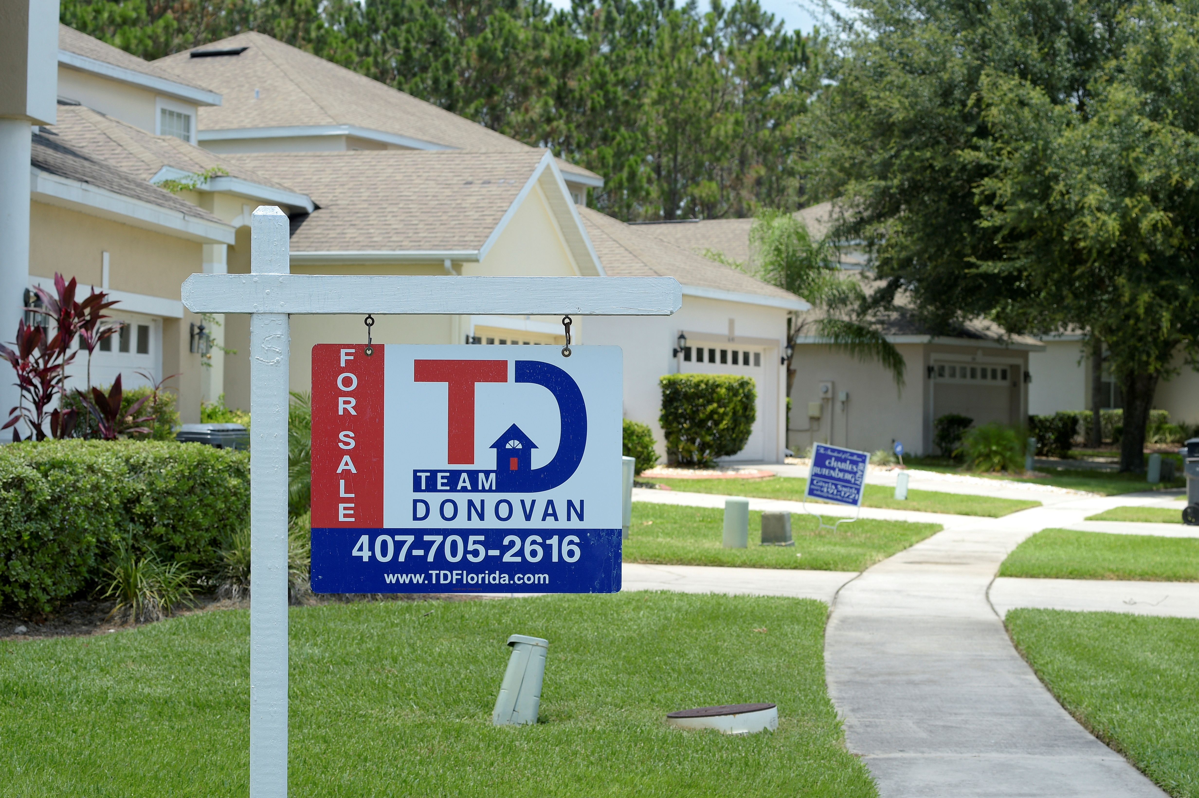 For Sale signs stand in front of houses in a neighborhood where many British people have purchased homes in Davenport, Florida, U.S., June 29, 2016.  Photo taken June 29, 2016. REUTERS/Phelan Ebenhack