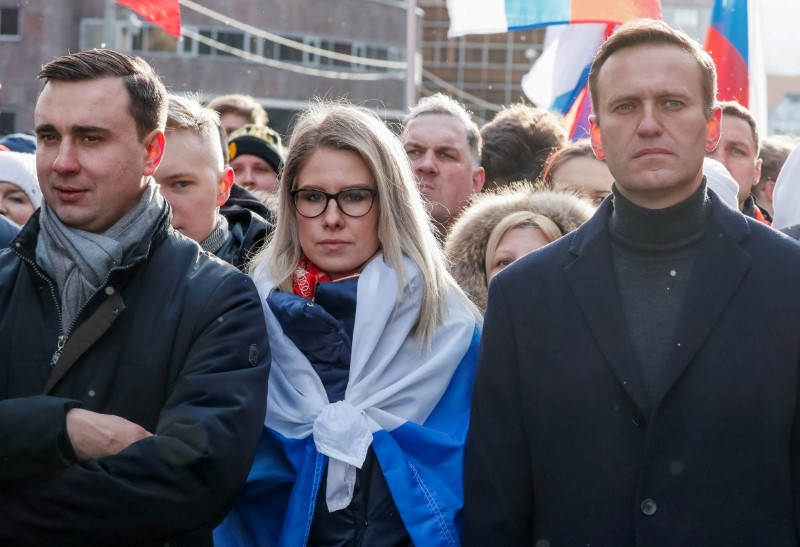 Russian opposition politicians Alexei Navalny, Lyubov Sobol and Ivan Zhdanov take part in a rally to mark the 5th anniversary of opposition politician Boris Nemtsov's murder and to protest against proposed amendments to the country's constitution, in Moscow, Russia February 29, 2020. REUTERS/Shamil Zhumatov/File Photo