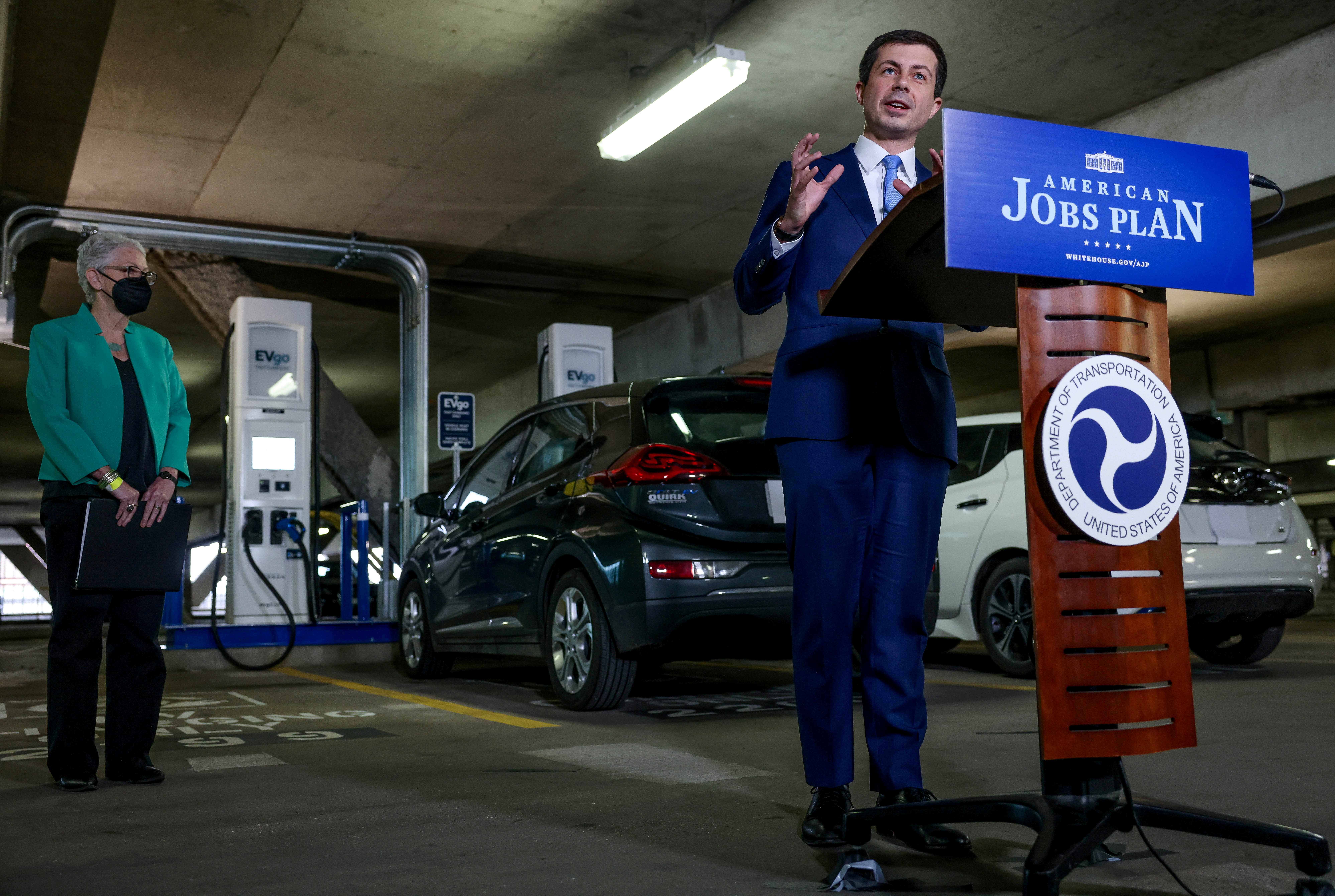 U.S. Transportation Secretary Pete Buttigieg and White House Climate Advisor Gina McCarthy, hold a news conference in the parking garage at Union Station in front of new EV charging stations in Washington, U.S., April 22, 2021. REUTERS/Evelyn Hockstein