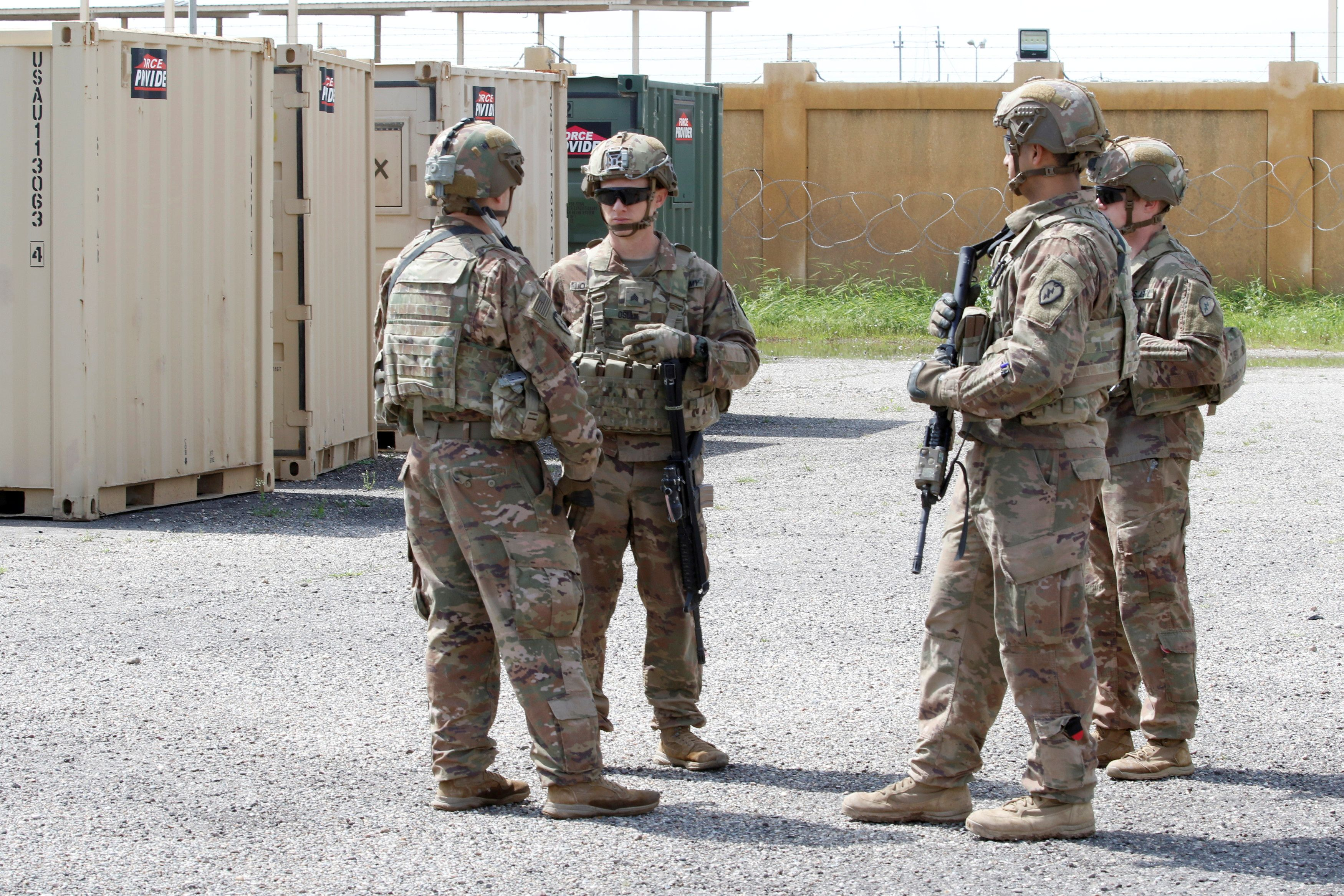 U.S. soldiers are seen before a handover ceremony of K-1 airbase from U.S.-led coalition forces to Iraqi security forces, in Kirkuk governorate, Iraq March 29, 2020. REUTERS/Ako Rasheed/File Photo