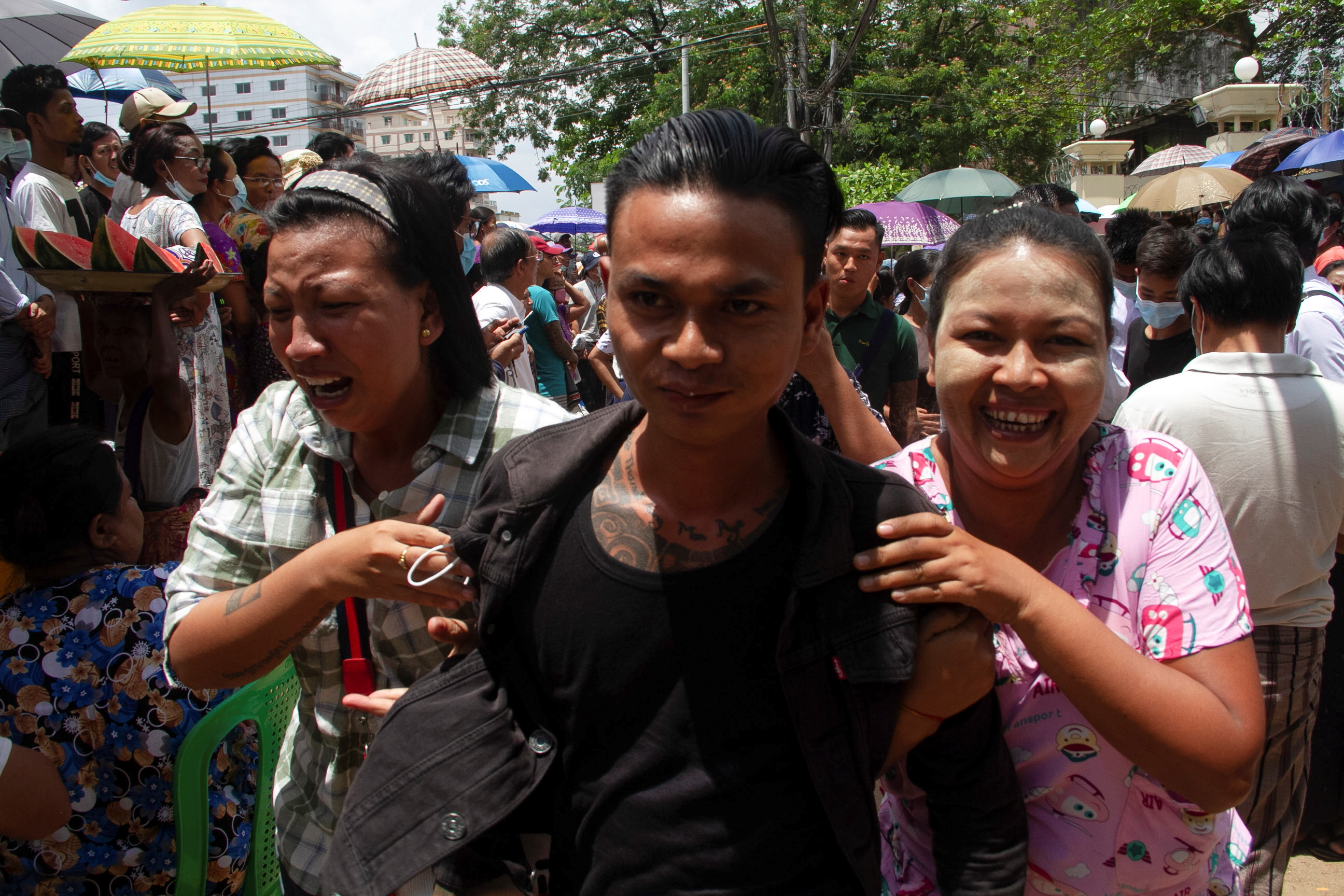 A released prisoner reacts with his relatives outside the Insein prison, as Myanmar's junta released 23,184 prisoners from jails across the country on Saturday under a New Year amnesty, in Yangon, Myanmar, April 17, 2021. REUTERS/Stringer