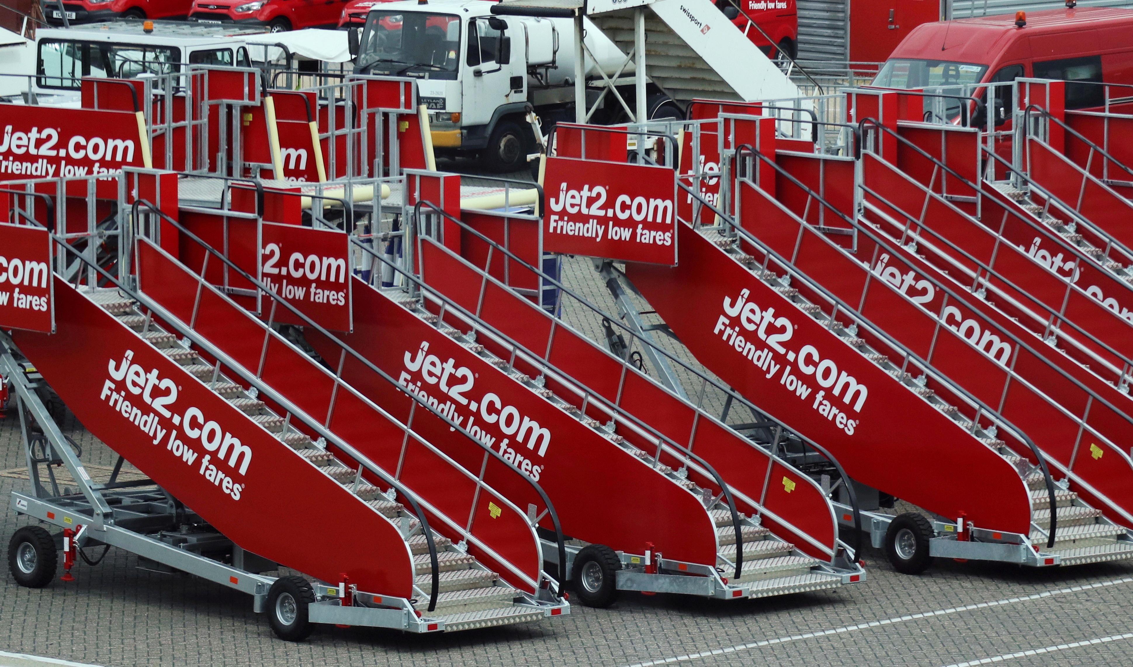 Jet2.com aircraft boarding stairs are stored at Stansted airport in Stansted, Britain June 30, 2017. Picture taken through glass. REUTERS/Russell Boyce/File Photo