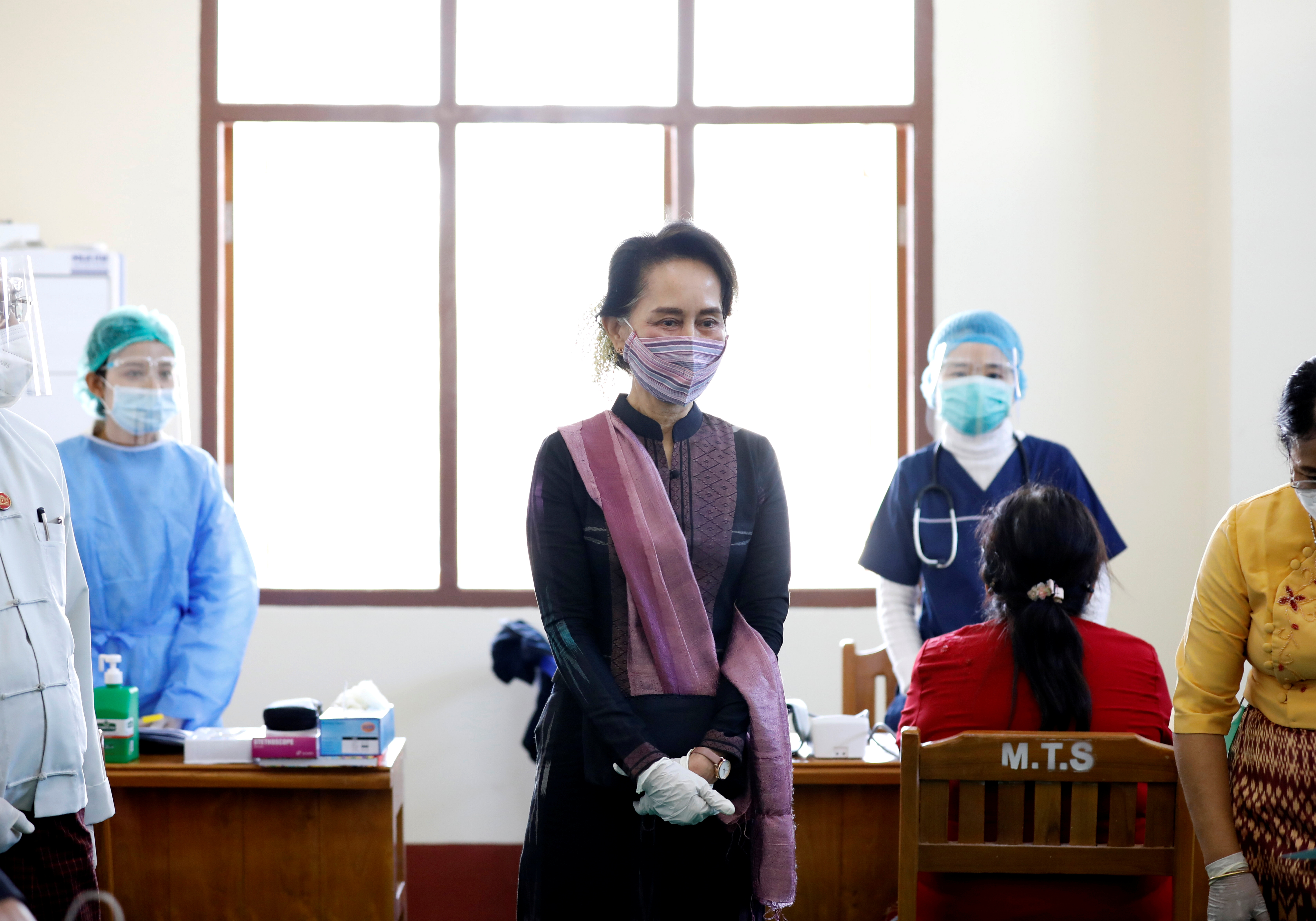 Myanmar State Counsellor Aung San Suu Kyi visits a hospital as medical workers receive the AstraZeneca