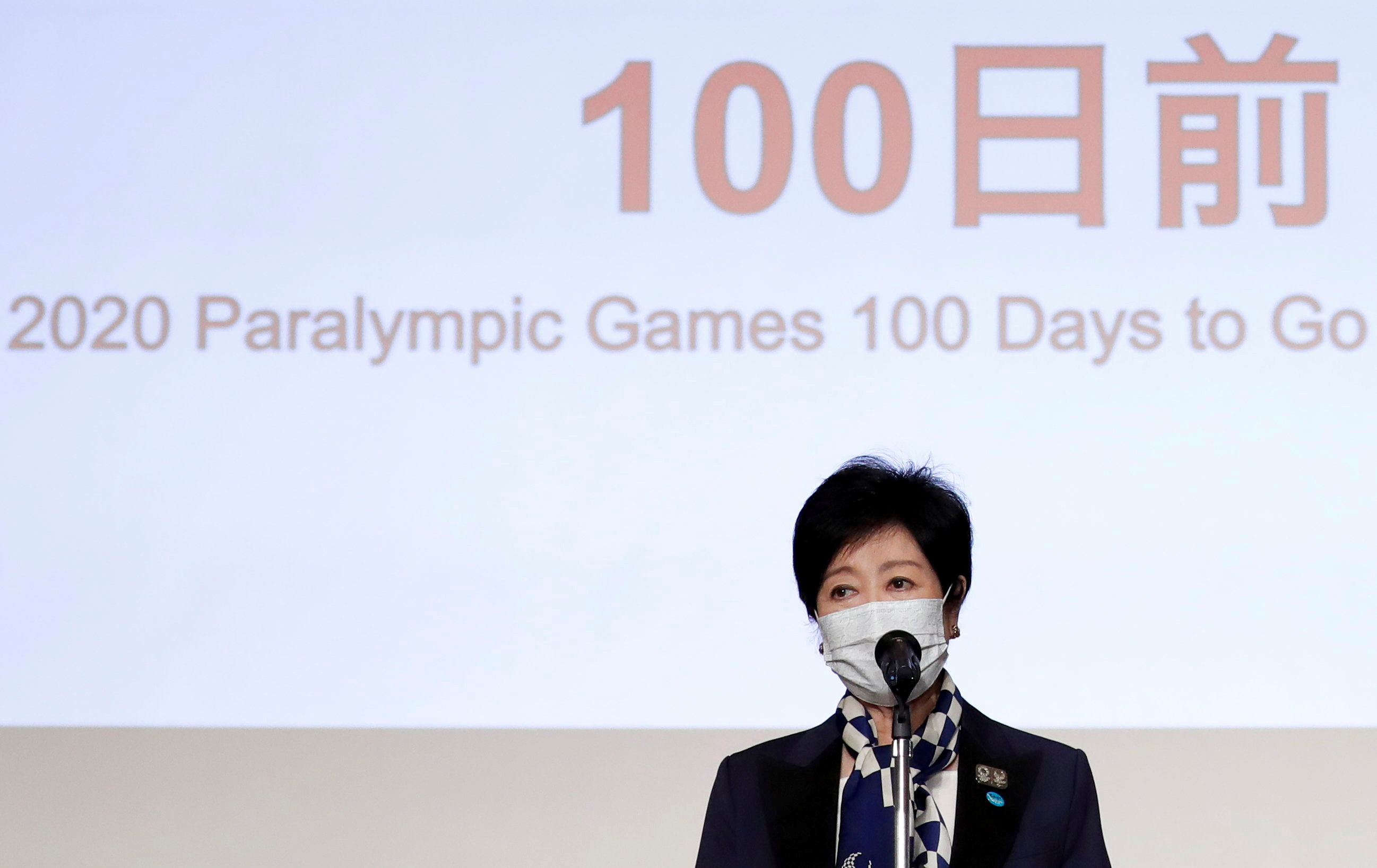 Tokyo Governor Yuriko Koike delivers a speech during  a ceremony to mark 100 days until the opening of the Tokyo 2020 Paralympic Games that have been postponed to 2021 due to the coronavirus disease (COVID-19) outbreak, at Tokyo Metropolitan Government building in Tokyo, Japan May 16, 2021. REUTERS/Issei Kato/Pool