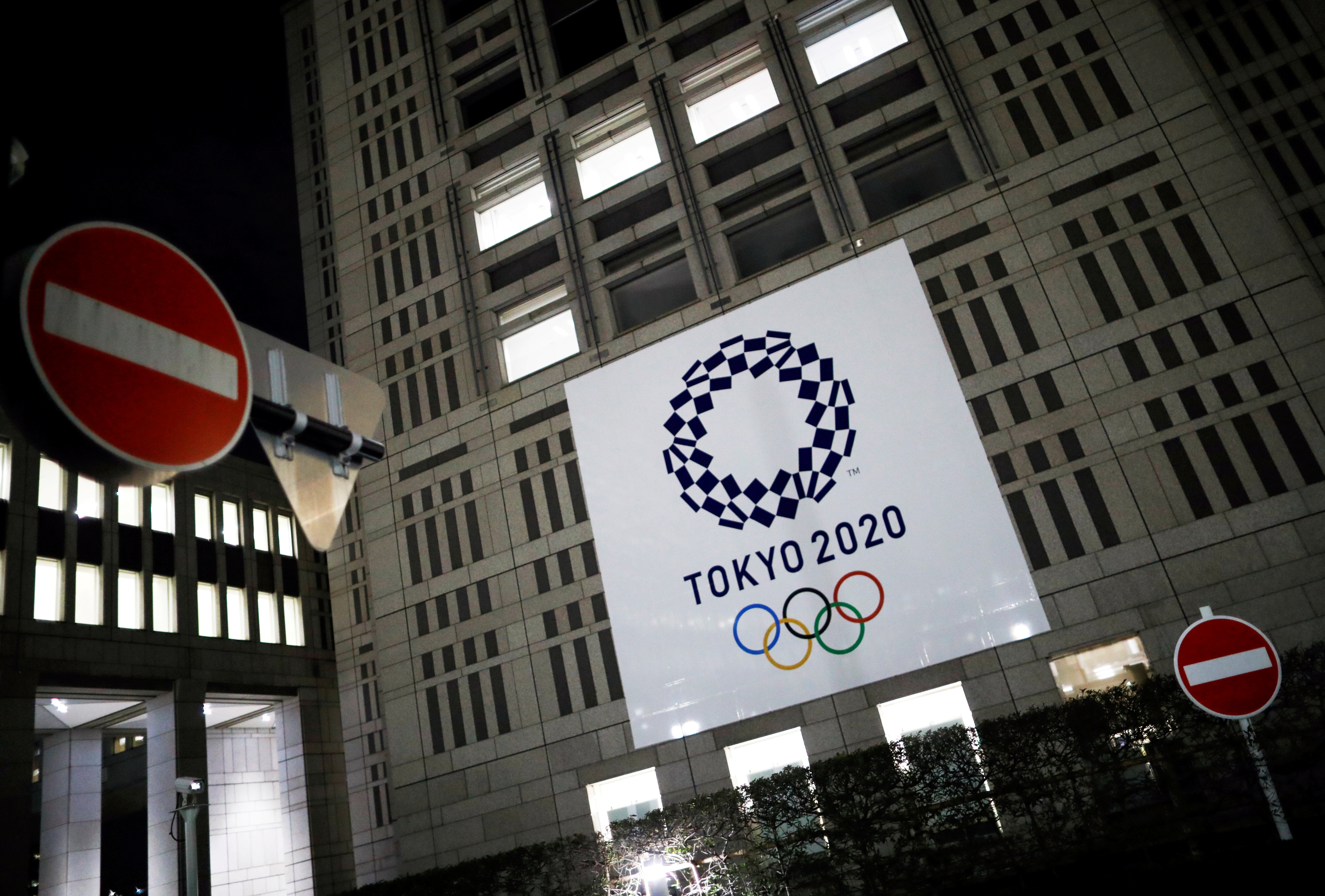 The logo of Tokyo 2020 Olympic Games that have been postponed to 2021 due to the coronavirus disease (COVID-19) outbreak, is seen through signboards, at Tokyo Metropolitan Government Office building in Tokyo, Japan January 22, 2021. REUTERS/Issei Kato
