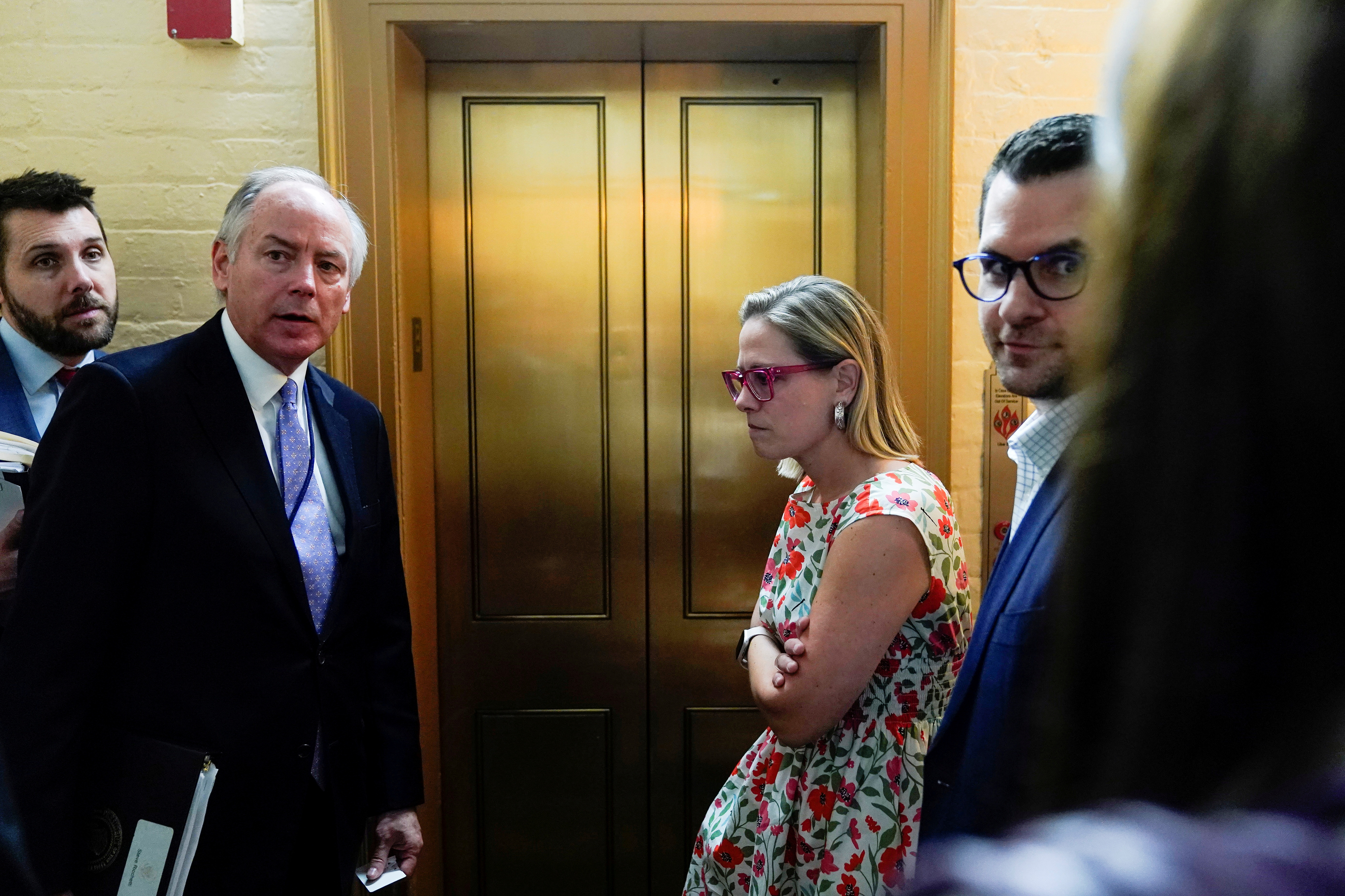 White House Counselor Steve Ricchetti and Senator Kyrsten Sinema (D-AZ) stand together after a bipartisan meeting on infrastructure on Capitol Hill in Washington, U.S., June 22, 2021.      REUTERS/Joshua Roberts/File Photo