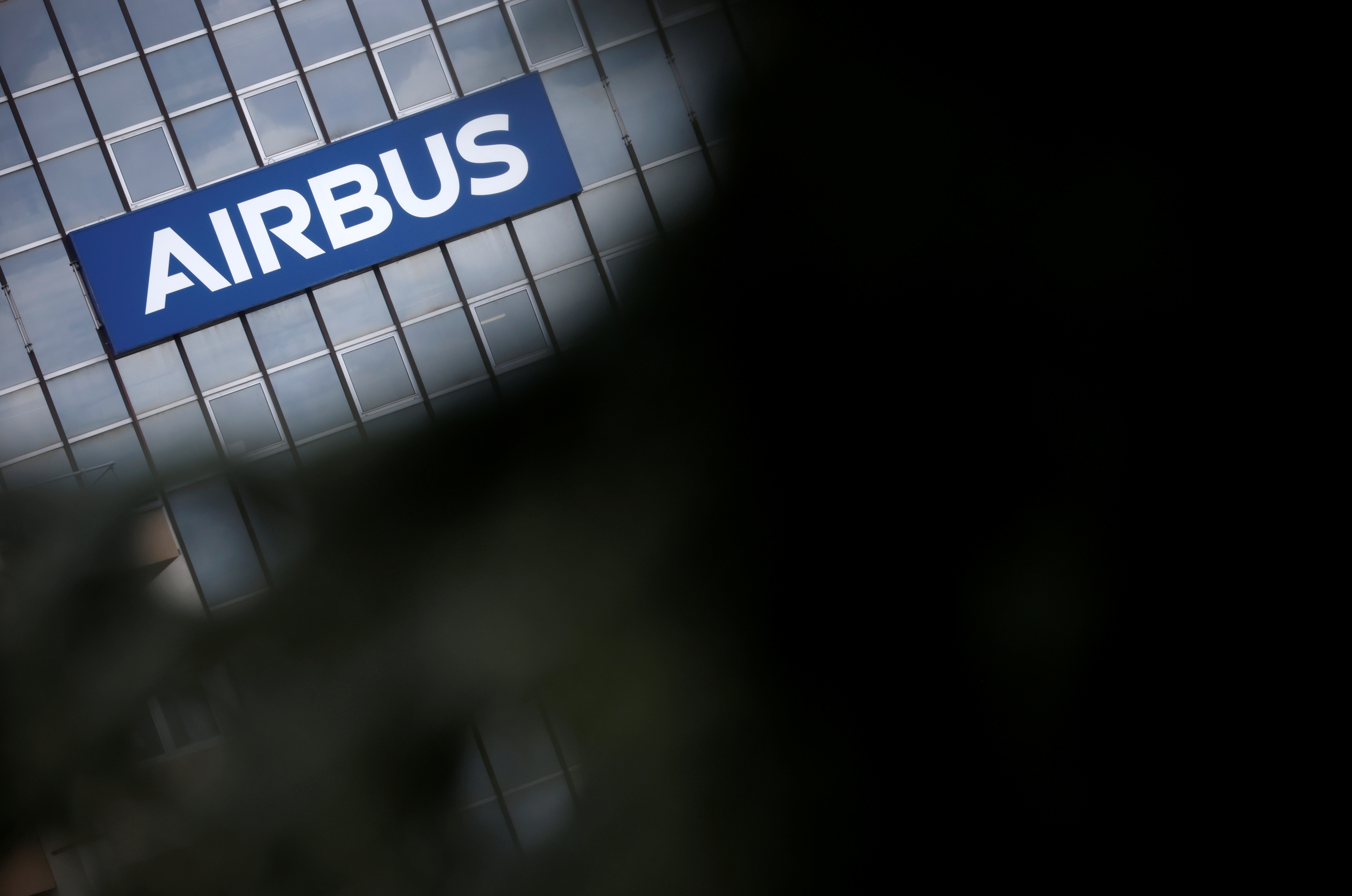 The logo of Airbus is seen on a building in Toulouse, France, March 11, 2021. REUTERS/Stephane Mahe/File Photo