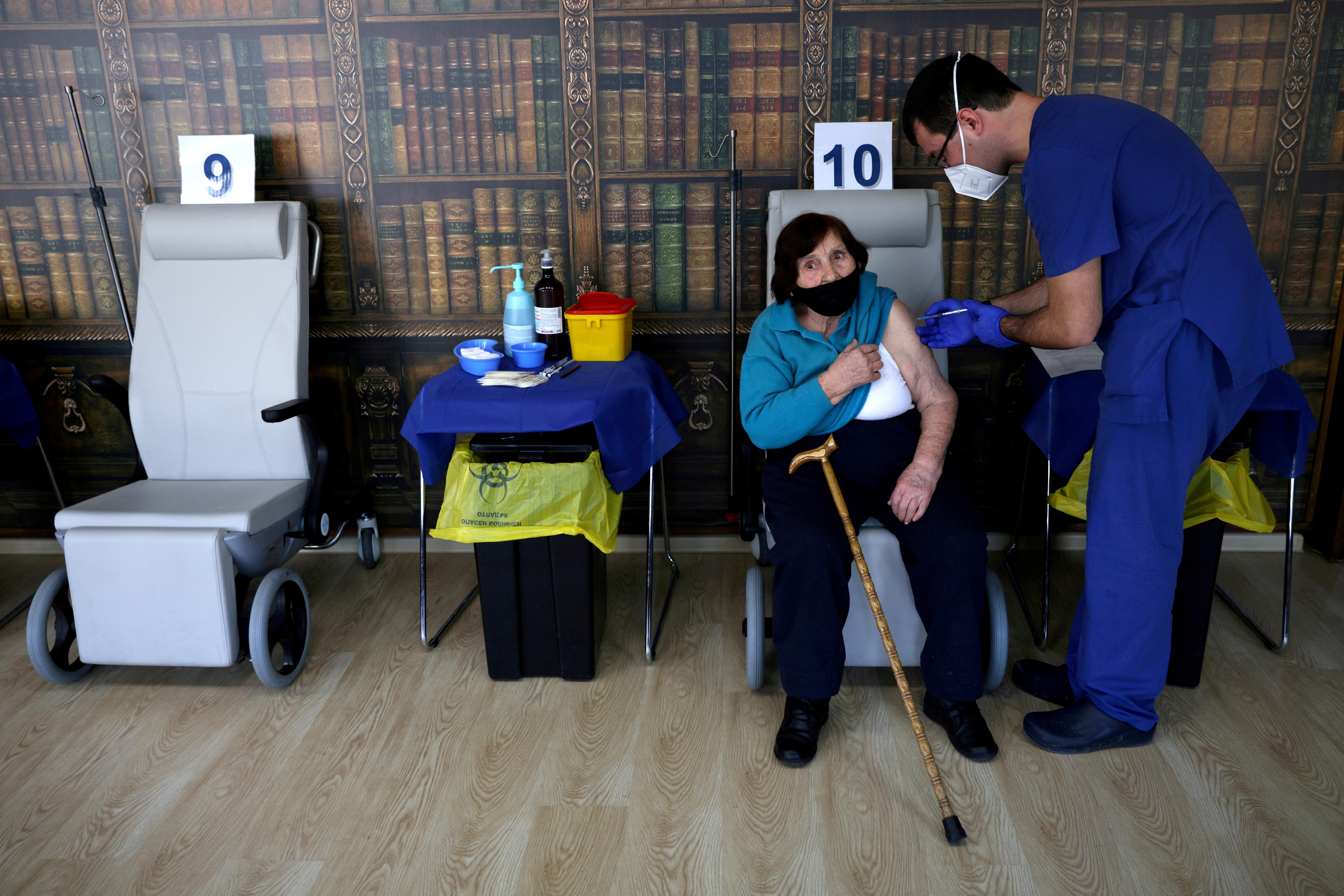 Lala Staribratova, 95, a World War II veteran receives a coronavirus disease (COVID-19) vaccine at the Military Medical Academy in Sofia, Bulgaria, February 23, 2021. REUTERS/Stoyan Nenov//File Photo
