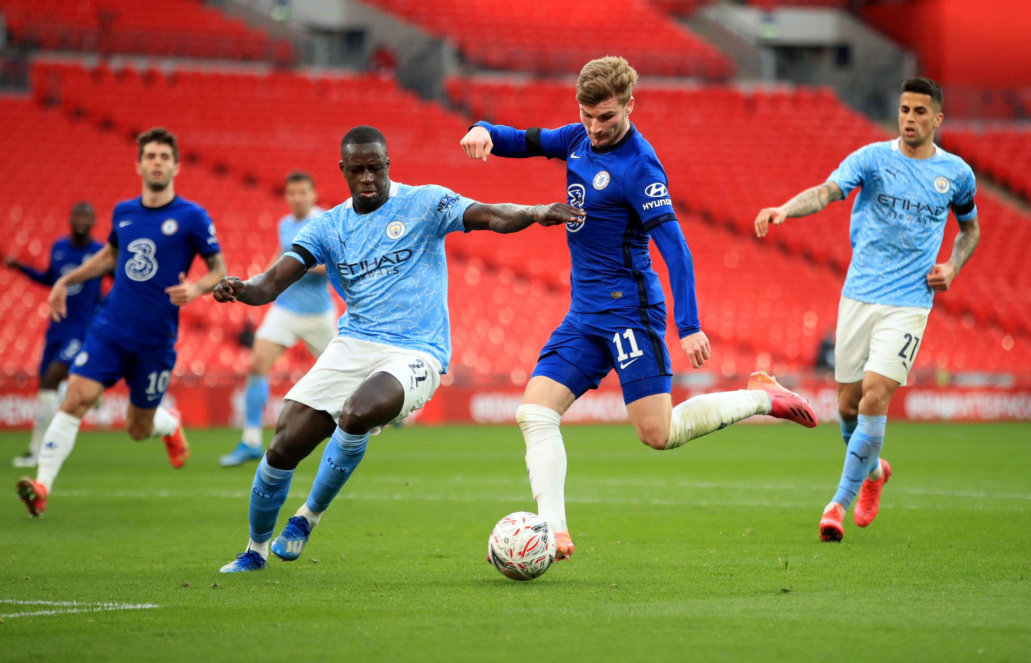 Soccer Football -  FA Cup Semi Final - Chelsea v Manchester City - Wembley Stadium, London, Britain - April 17, 2021 Manchester City's Benjamin Mendy in action with Chelsea's Timo Werner Pool via REUTERS/Adam Davy