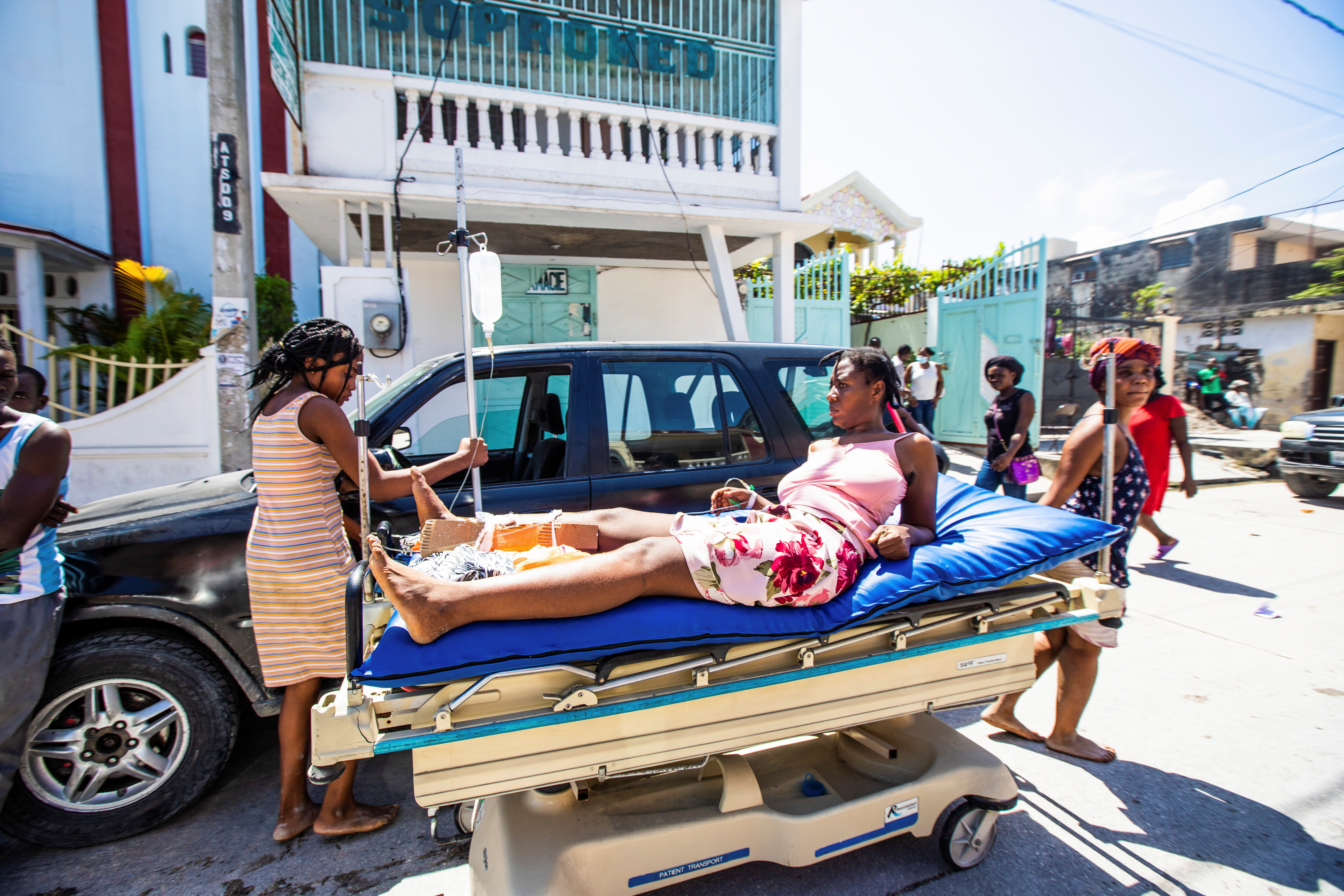 A woman injured during the 7.2 magnitude earthquake lies on a stretcher in Les Cayes, Haiti August 14, 2021. REUTERS/Ralph Tedy Erol NO RESALES. NO ARCHIVES