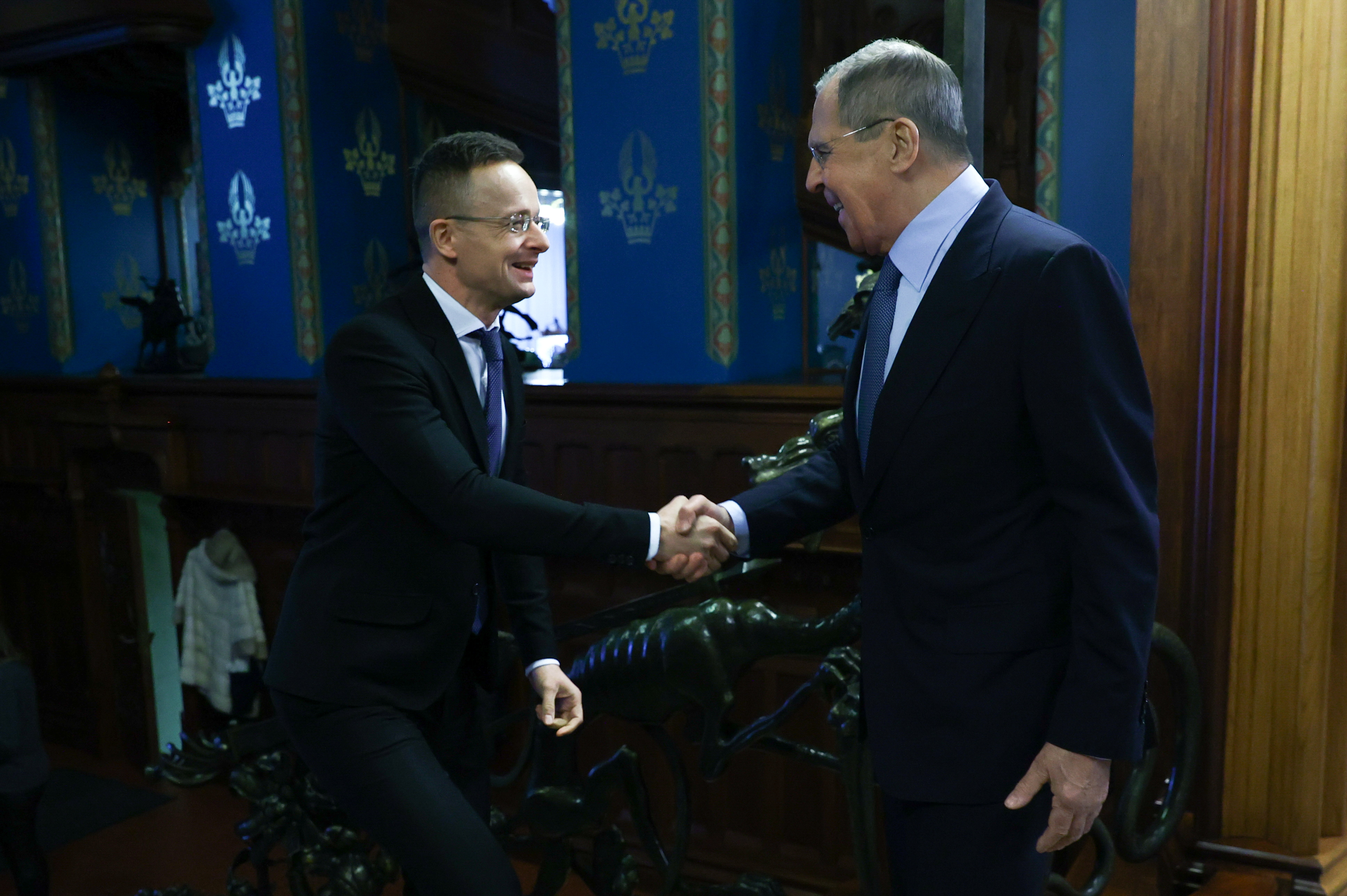 Russian Foreign Minister Sergei Lavrov greets Hungarian Foreign Minister Peter Szijjarto during a meeting in Moscow, Russia January 22, 2021. Russian Foreign Ministry/Handout via REUTERS