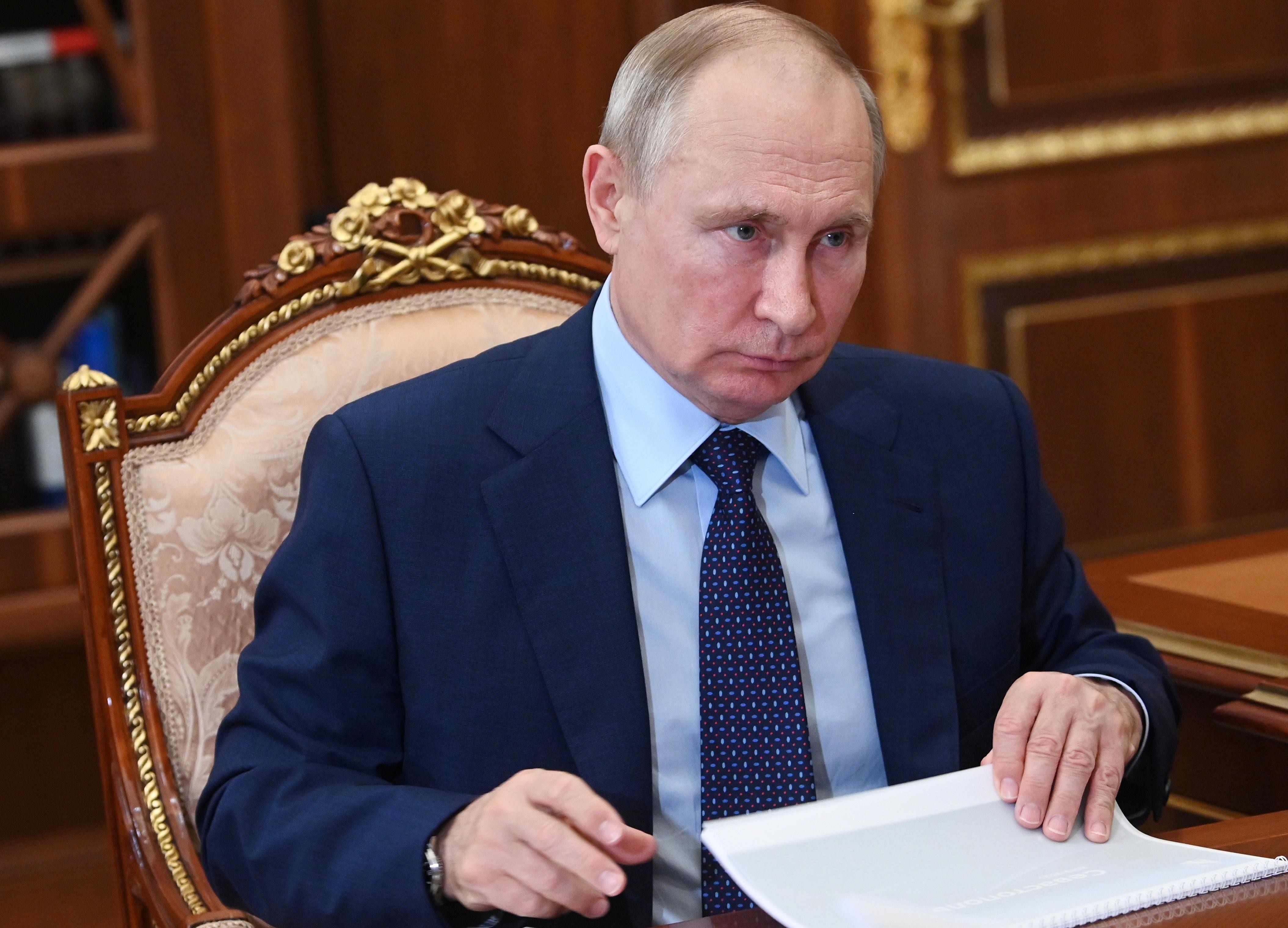 Russian President Vladimir Putin attends a meeting with Governor of Sevastopol Mikhail Razvozhayev at the Kremlin in Moscow, Russia August 11, 2021. Sputnik/Alexei Nikolsky/Kremlin via REUTERS