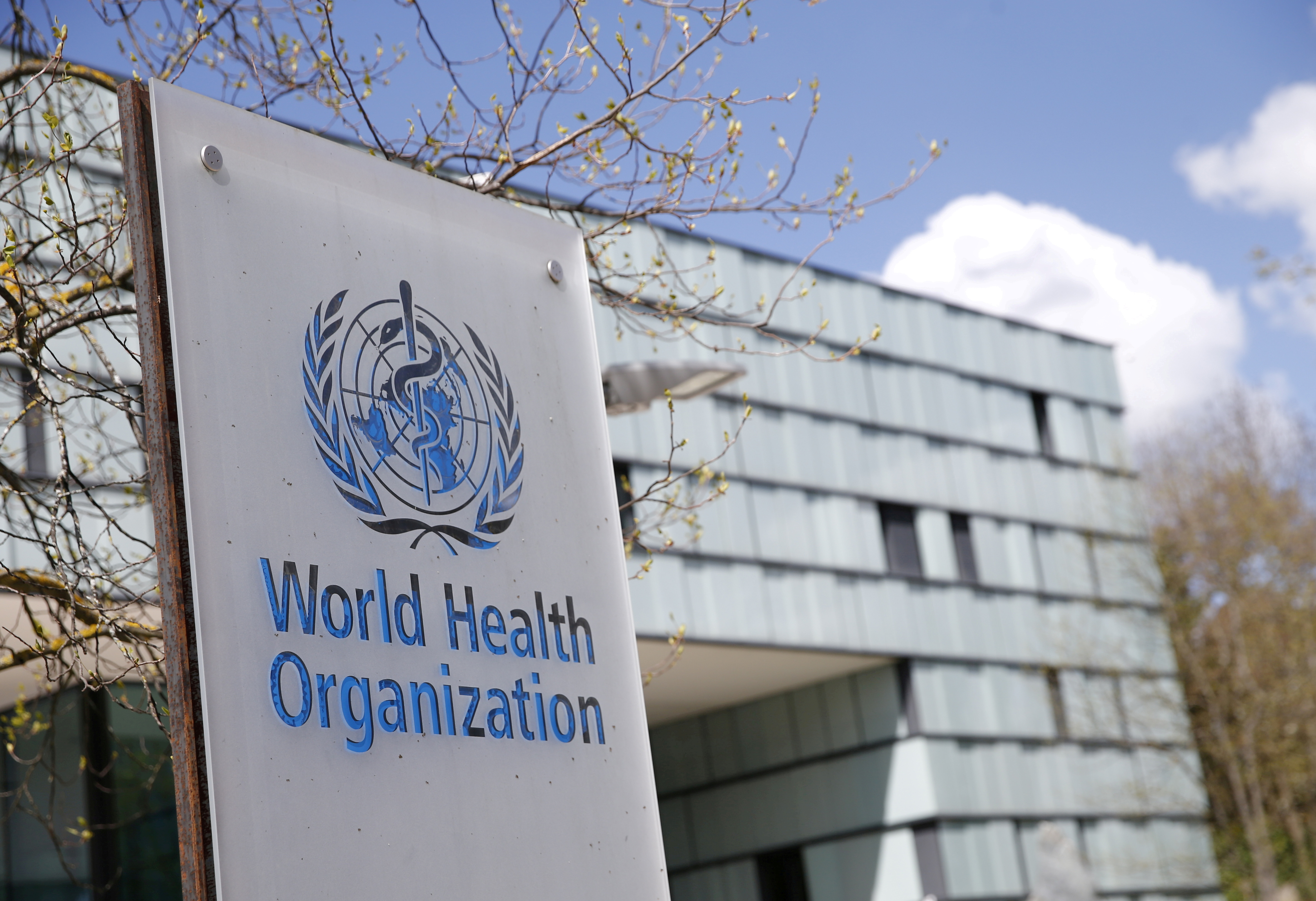 A logo is pictured outside a building of the World Health Organization (WHO) during an executive board meeting on update on the coronavirus disease (COVID-19) outbreak, in Geneva, Switzerland, April 6, 2021. REUTERS/Denis Balibouse/File Photo