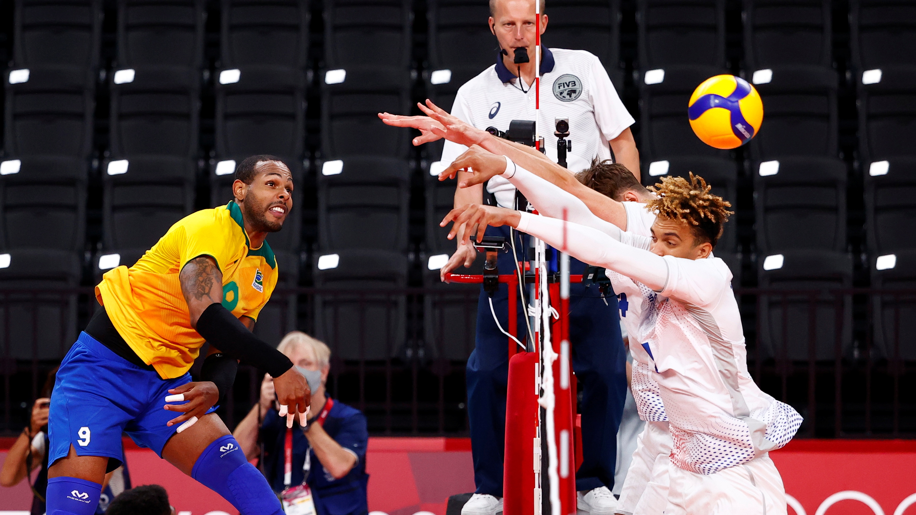 Tokyo 2020 Olympics - Volleyball - Men's Pool B - Brazil v France - Ariake Arena, Tokyo, Japan – August 1, 2021. Leal of Brazil in action with Barthelemy Chinenyeze of France. REUTERS/Carlos Garcia Rawlins