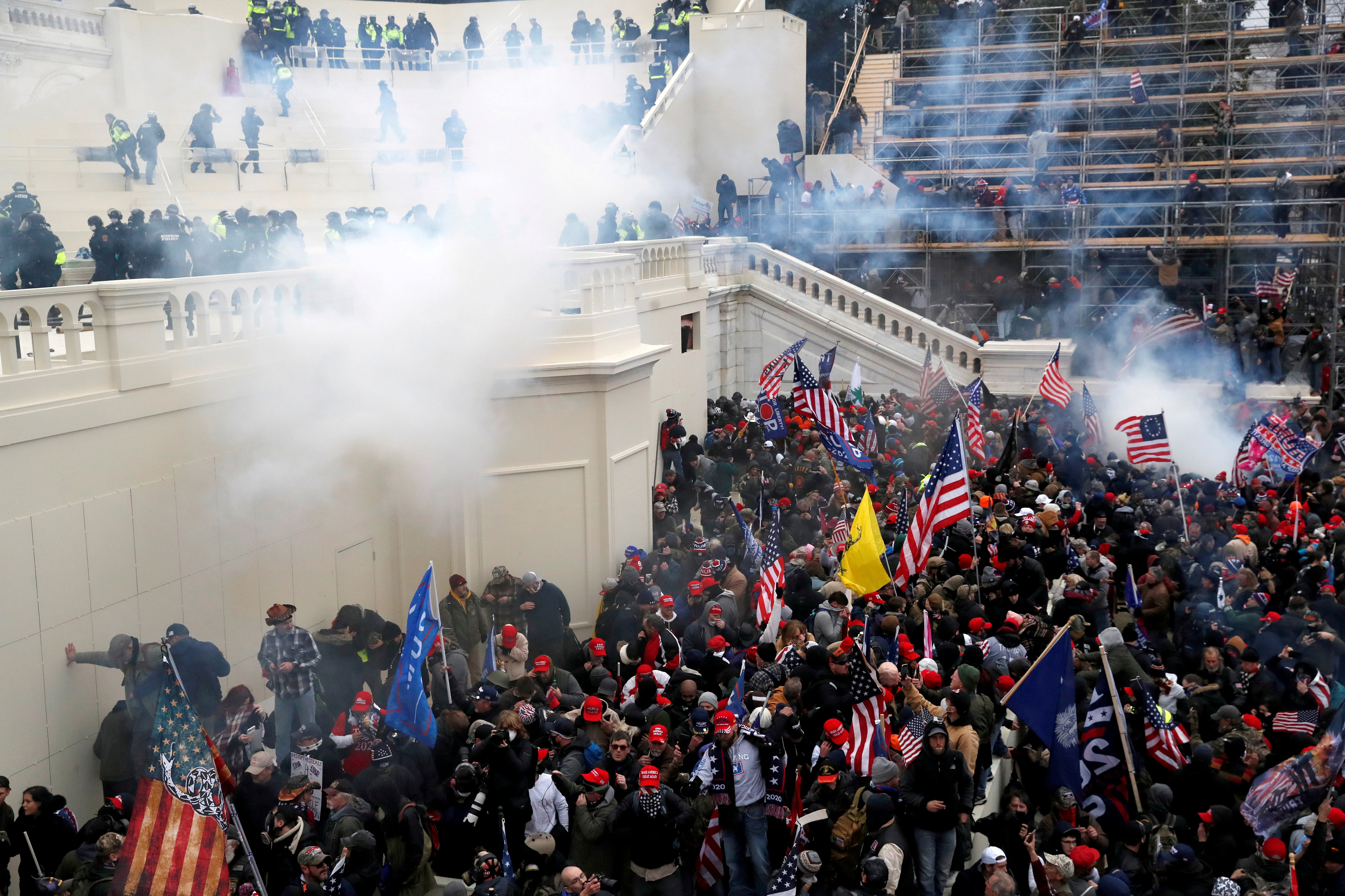 Police release tear gas into a crowd of pro-Trump protesters during clashes at a rally to contest the certification of the 2020 U.S. presidential election results by the U.S. Congress, at the U.S. Capitol Building in Washington, U.S, January 6, 2021. REUTERS/Shannon Stapleton/File Photo