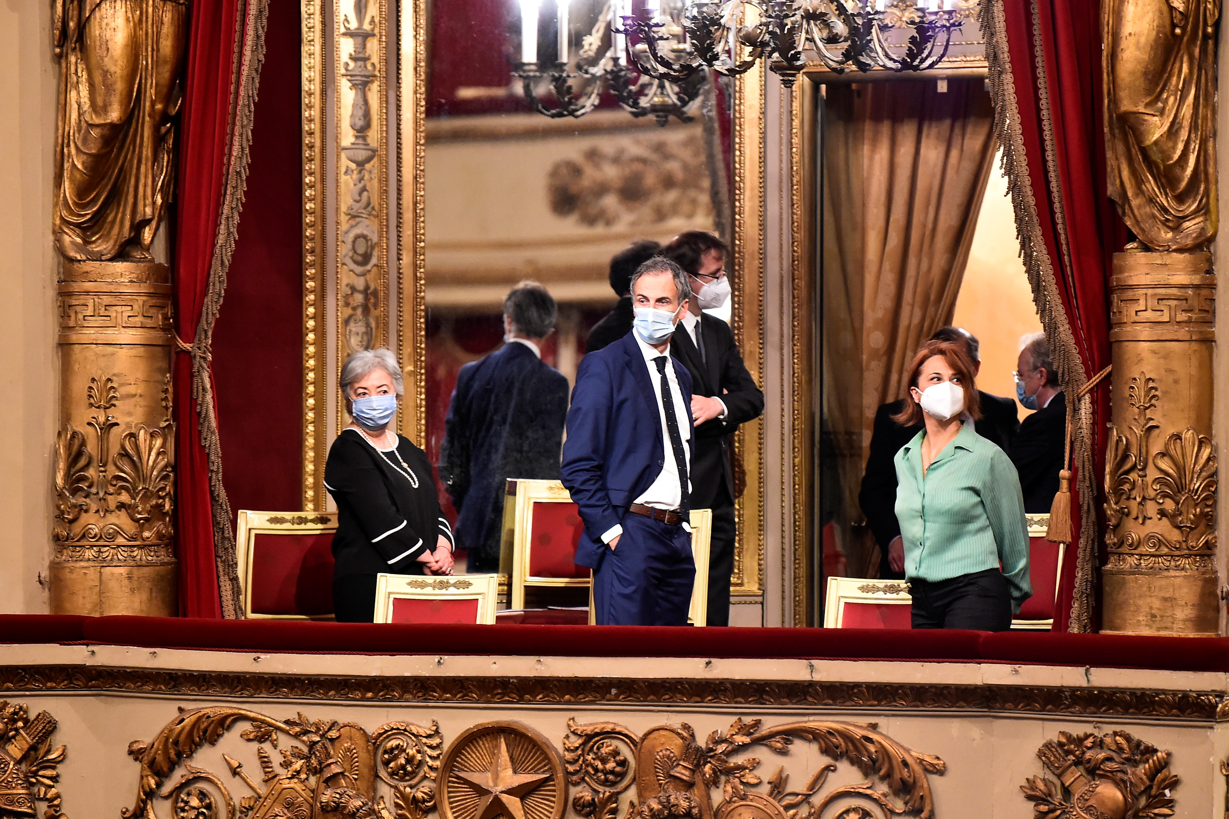 People attend the re-opening of La Scala opera house after it was closed due to the coronavirus disease (COVID-19) pandemic, in Milan, Italy, May 10, 2021. REUTERS/Flavio Lo Scalzo