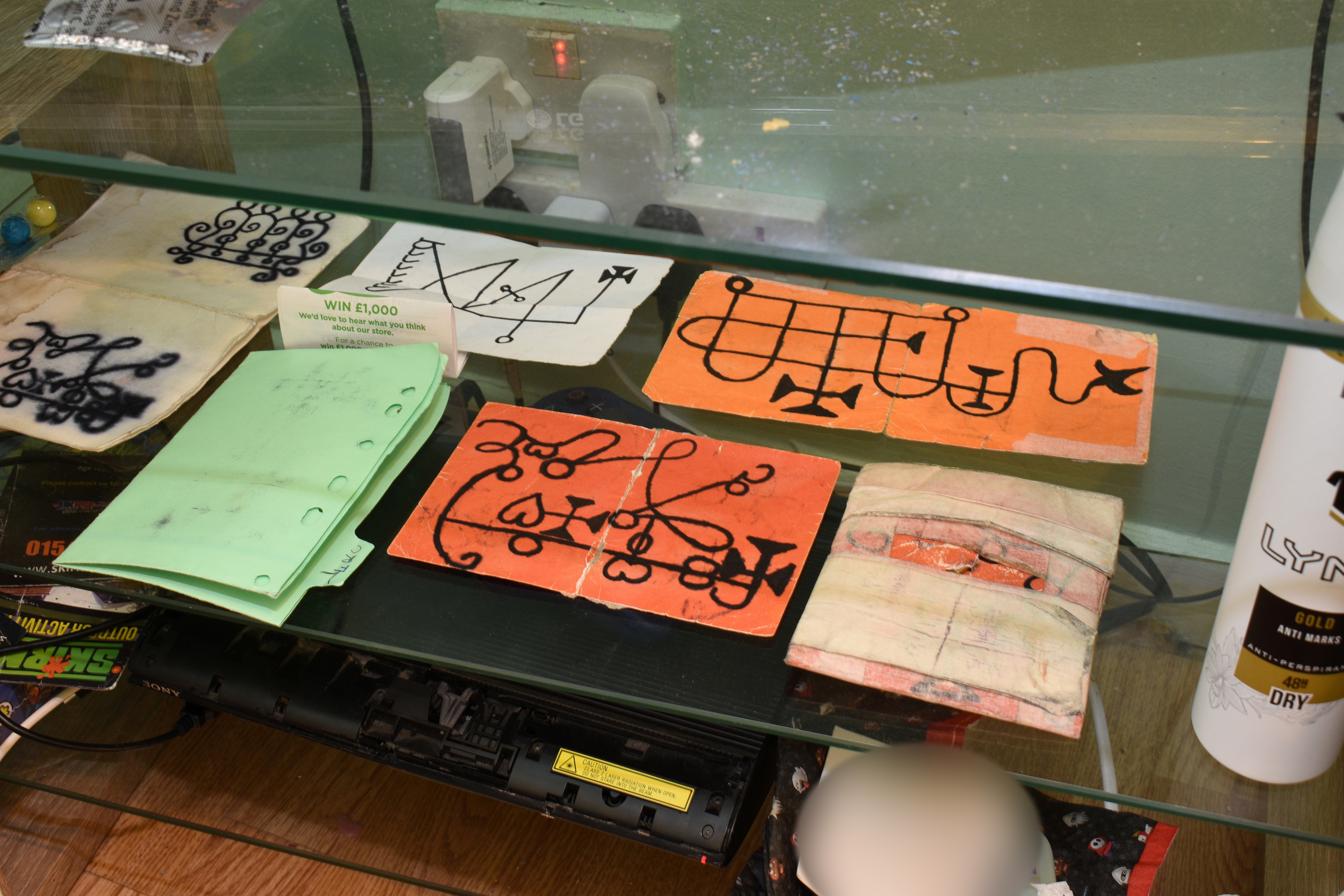 A handwritten book of spells, symbols and lottery tickets are pictured inside the house of Danyal Hussein, British teenager who was found guilty on July 6, 2021 of murdering two women in a London park in June 2020 as part of a demonic pact to win lottery, in this undated handout picture.    Metropolitan Police/Handout via REUTERS