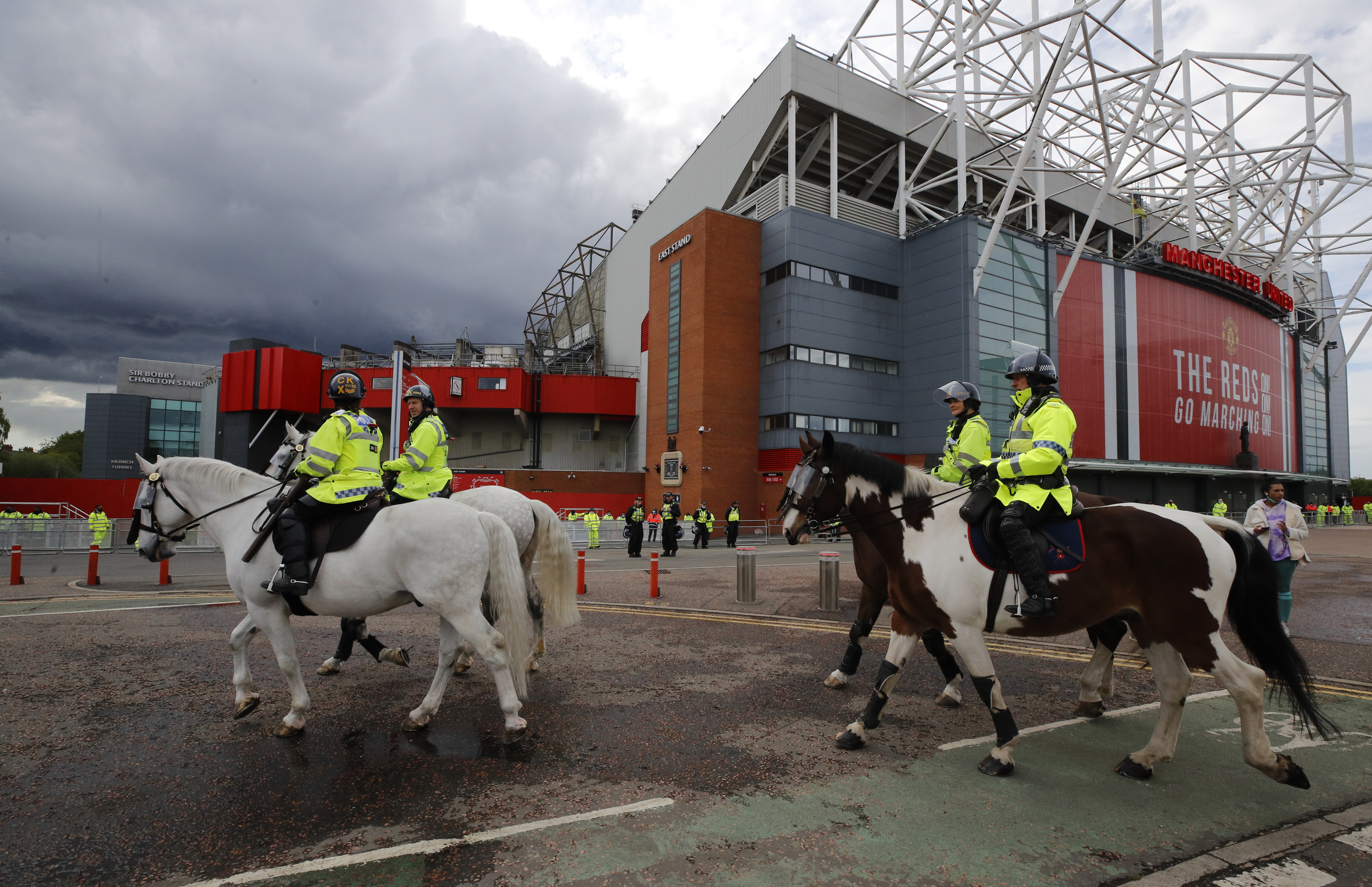 Soccer Football - Premier League - Manchester United v Leicester City - Old Trafford, Manchester, Britain - May 11, 2021 General view as Police stand guard outside the stadium before the match Reuters/Phil Noble