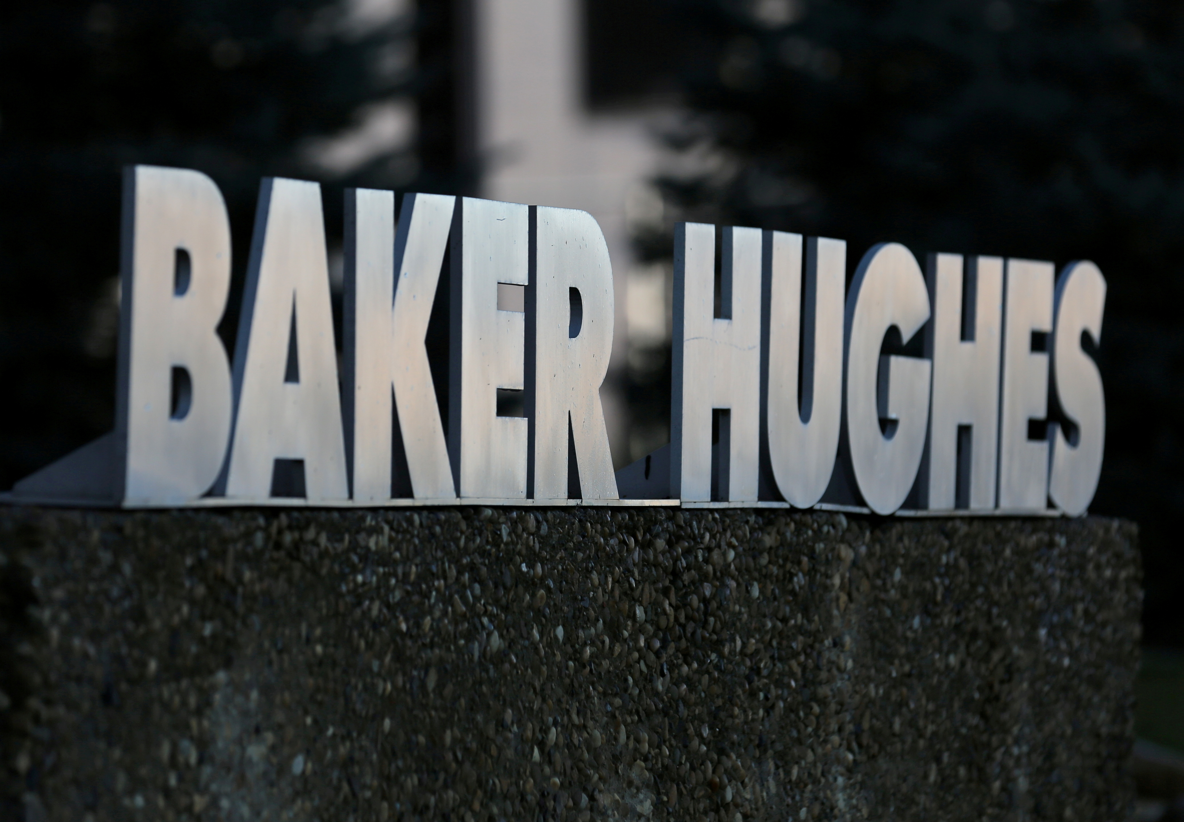 A Baker Hughes sign is displayed outside the oil logistics company's local office in Sherwood Park, near Edmonton, Alberta, Canada November 13, 2016. REUTERS/Chris Helgren/File Photo