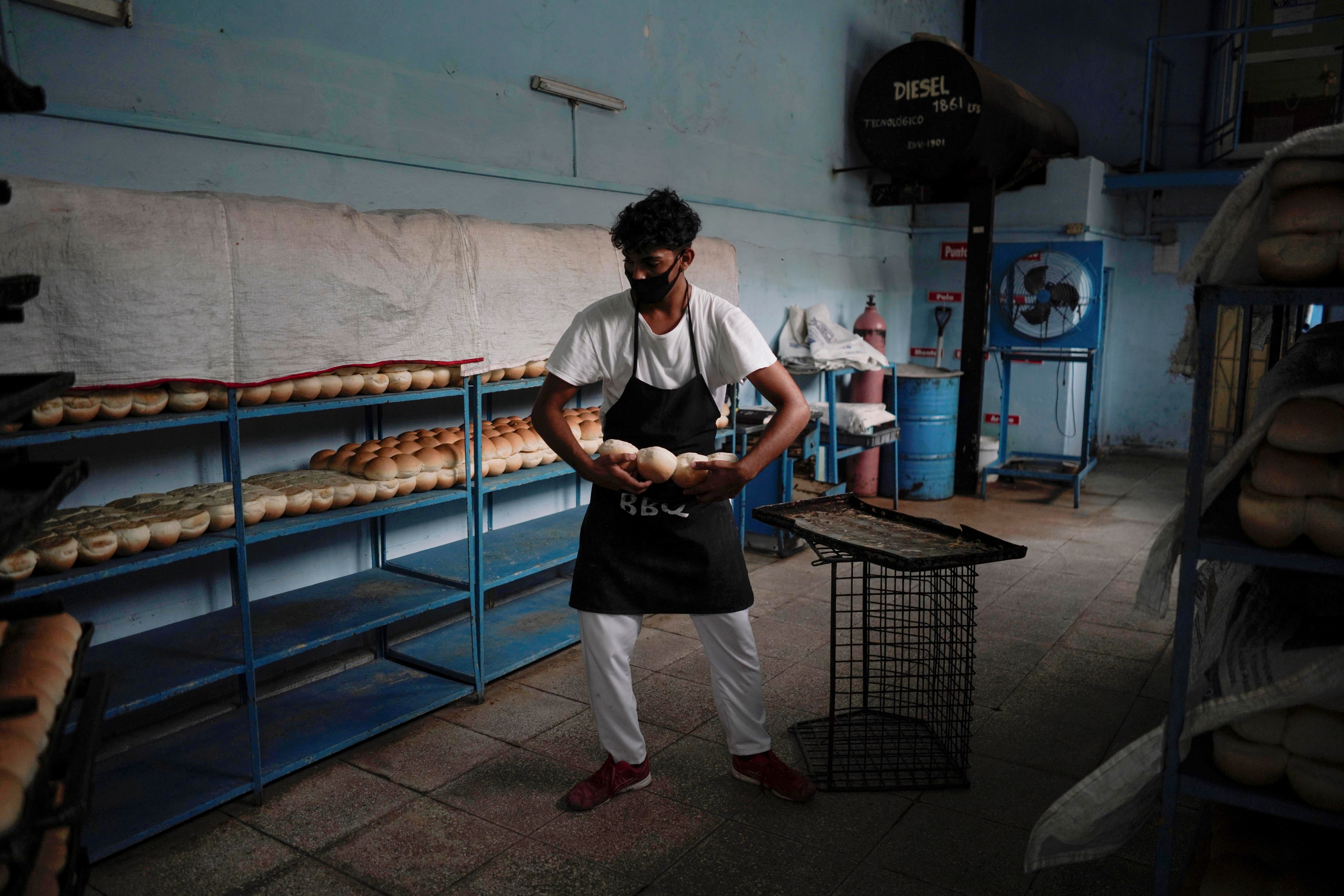 An employee carries bread inside a bakery in Havana, Cuba, May 18, 2021. Picture taken on May 18, 2021. REUTERS/Alexandre Meneghini