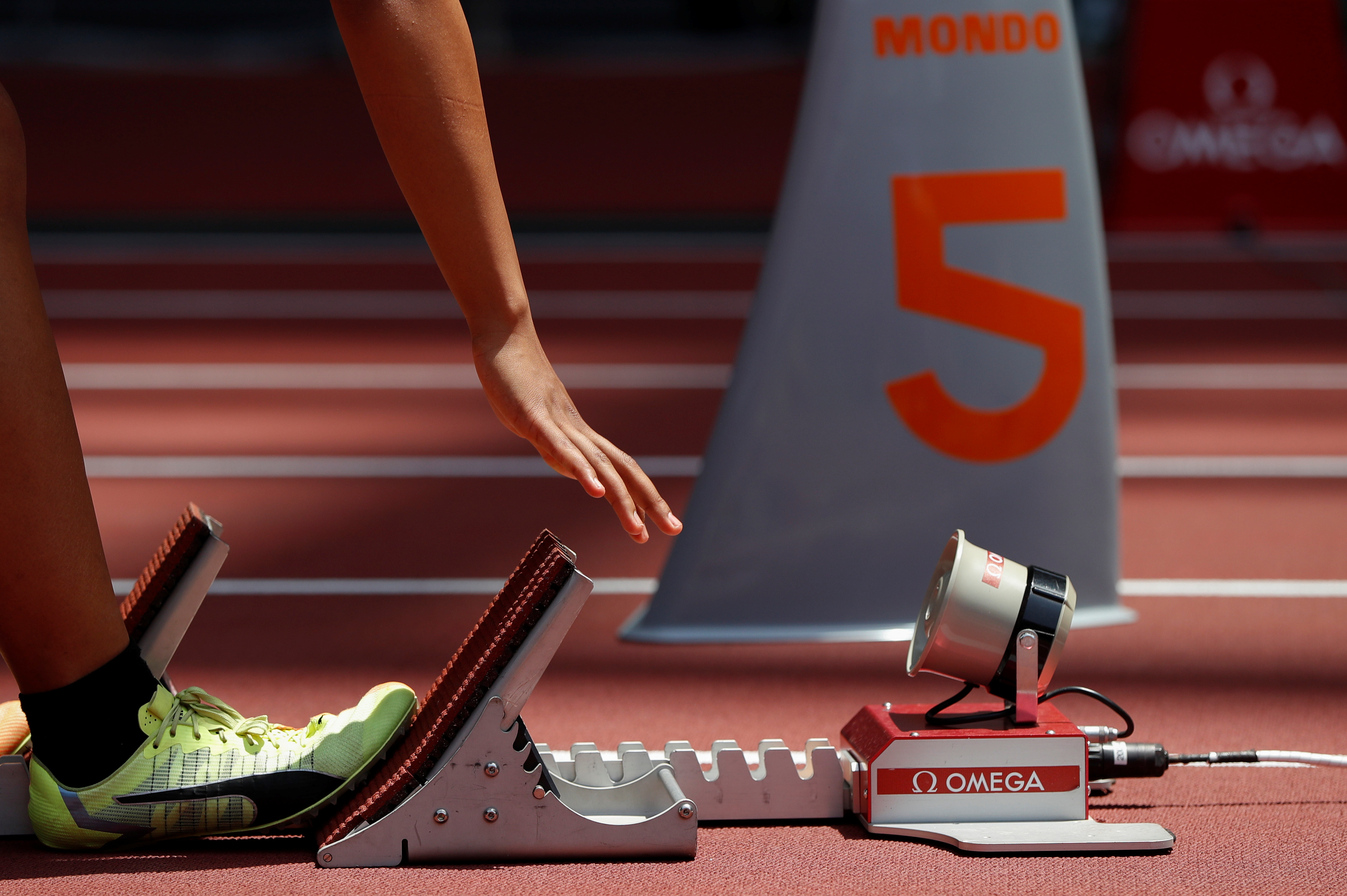 Olympics - Tokyo 2020 Olympic Games Test Event - Athletics - Olympic Stadium, Tokyo, Japan - May 9, 2021.   A close-up view of a starting block is seen on the track during the morning session of the Athletics test event. REUTERS/Issei Kato