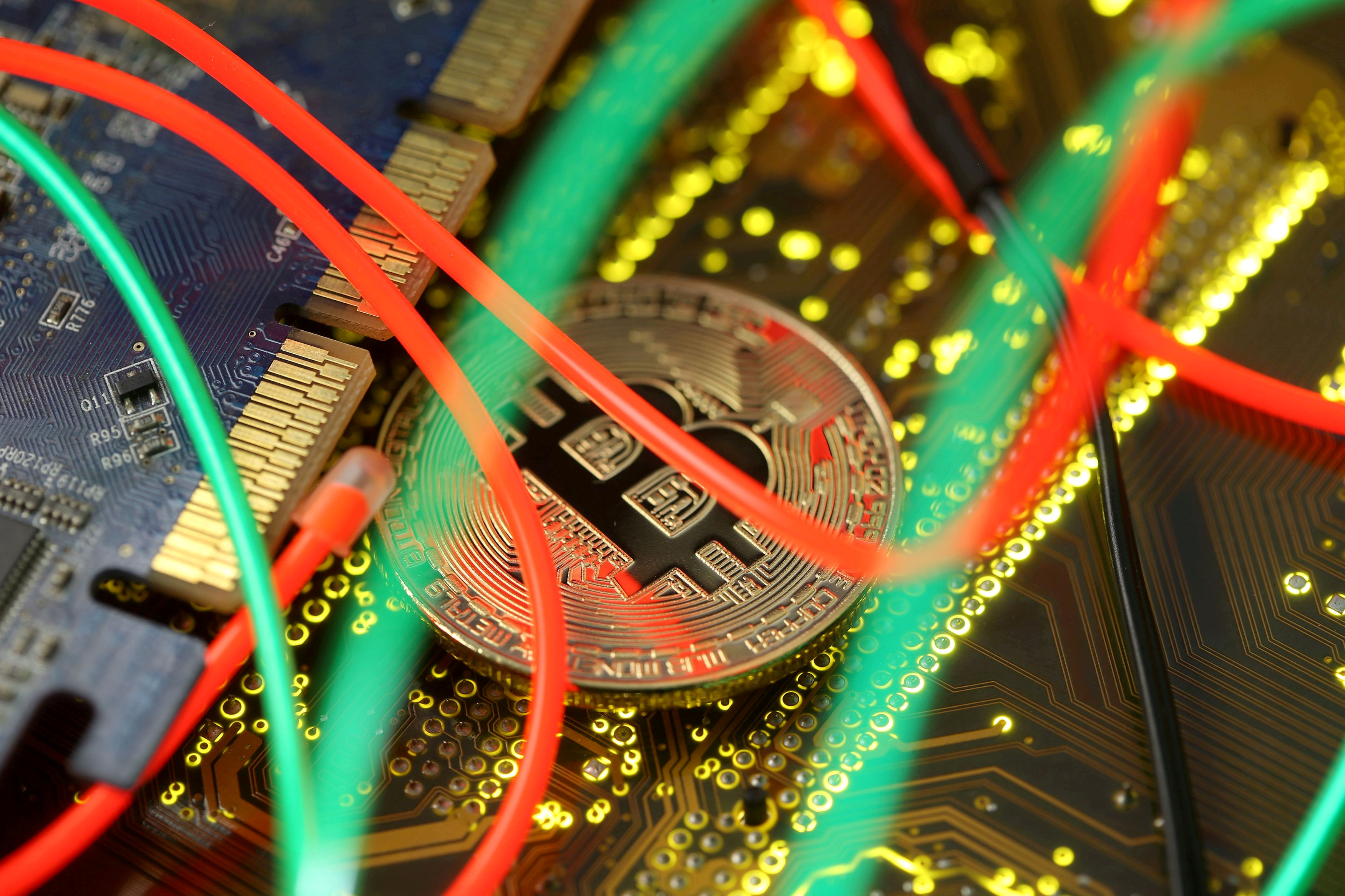 Representation of the bitcoin virtual currency standing on the PC motherboard is seen in this illustration picture, February 3, 2018. REUTERS/Dado Ruvic/File Photo
